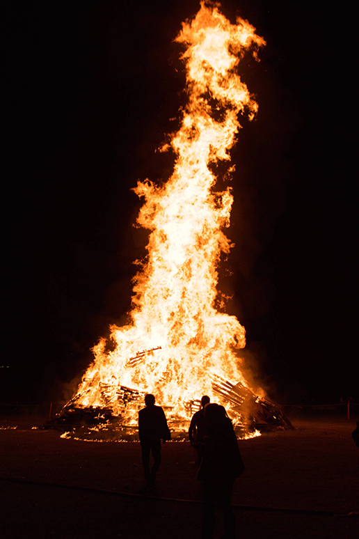 Students look on towards the massive flames at the Lehigh After Dark event Slow Burn at Goodman Campus on Thursday, November 17, 2016. Students were in awe at the size of the flames. (Sarah Epstein/B&W Staff)