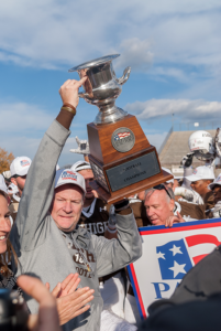 Head coach Andy Coen raises one of the Patriot League Championship trophies during Lehigh's celebrations following victory over Bucknell, Saturday, Nov. 5, 2016, in Goodman Stadium. Coen was named the Patriot League Coach of the Year at the end of the season. (Roshan Giyanani/B&W Staff)