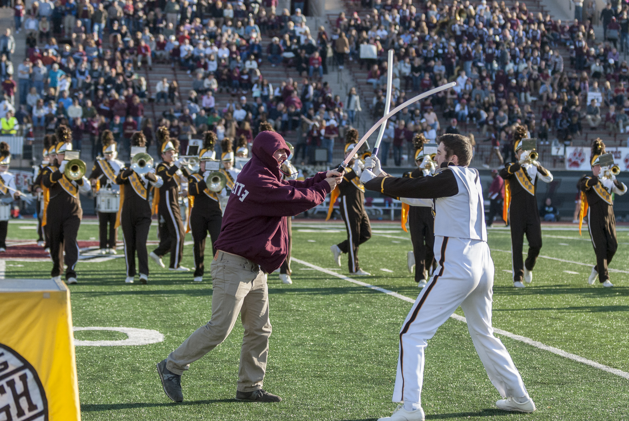 "Jon Wood, '17,  the drum major for Lehigh's Marching 97 engages in a lightsaber battle with Rob Weaver, '18, dressed up as a Lafayette student at the Lehigh-Lafayette football game on Saturday, Nov. 19, 2016, in Fisher Stadium. The band incorporated a song from ""Star Wars Episode 1"" in its halftime performance. (Roshan Giyanani/B&W Staff)"
