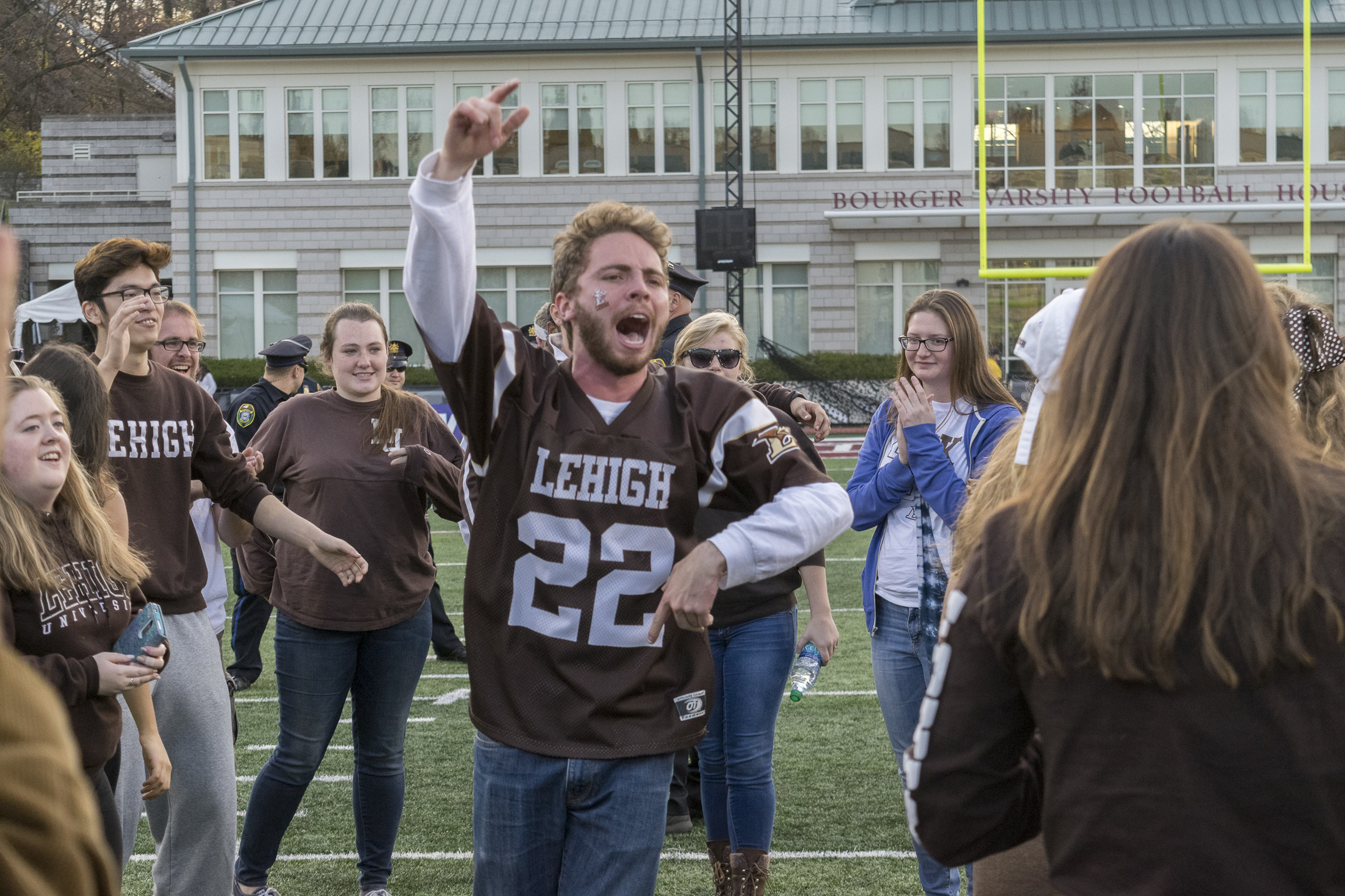 John Larson, '17, celebrates after Lehigh's victory over Lafayette on Saturday, Nov. 19, 2016, in Fisher Stadium. Students stormed the field following the win. (Roshan Giyanani/B&W Staff)