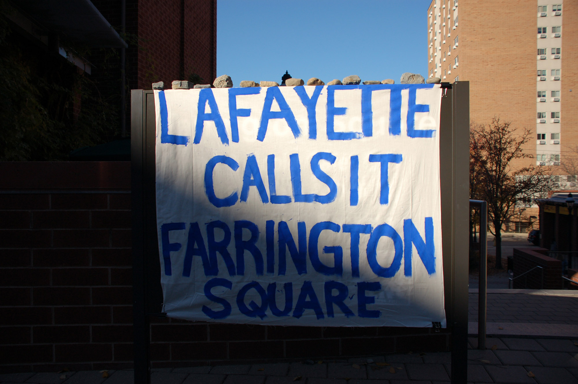 "A sign reading ""Lafayette calls it Farrington Square"" hangs on a sign at Farrington Square on Nov. 18, 2016. The area used to be called Campus Square and some students still refer to it by its old name. (Gaby Morera/B&W Staff)"