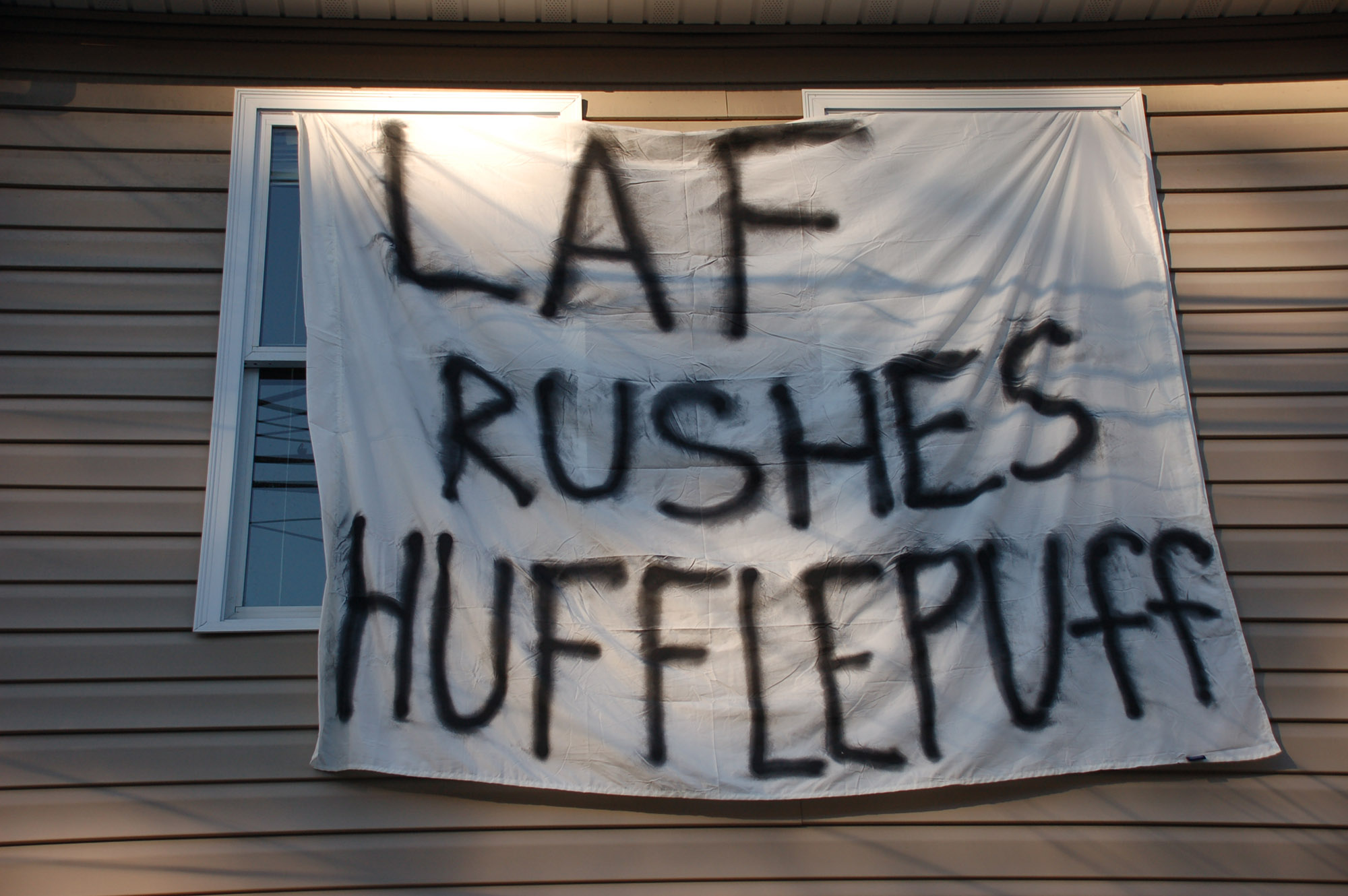 "A sign reading ""Laf rushes Hufflepuff"" hangs on a house on East Fifth Street on Nov. 18, 2016. The sign references the housing system from the Harry Potter books. (Gaby Morera/B&W Staff)"