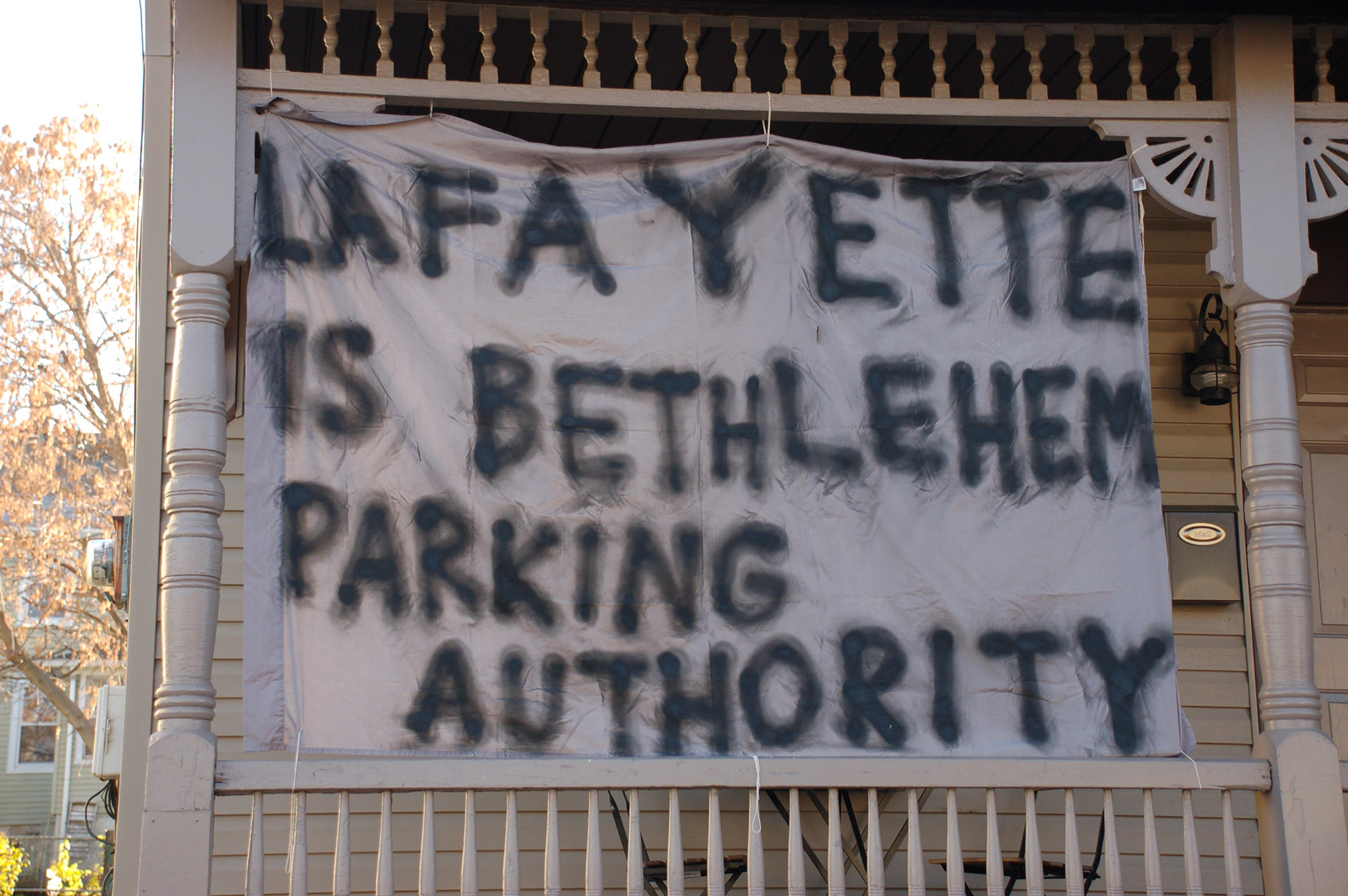 "A sign reading ""Lafayette is Bethlehem Parking Authority"" hangs on a house on East Fifth Street on Nov. 18, 2016. Lehigh students are often frustrated with the local parking services. (Gaby Morera/B&W Staff)"