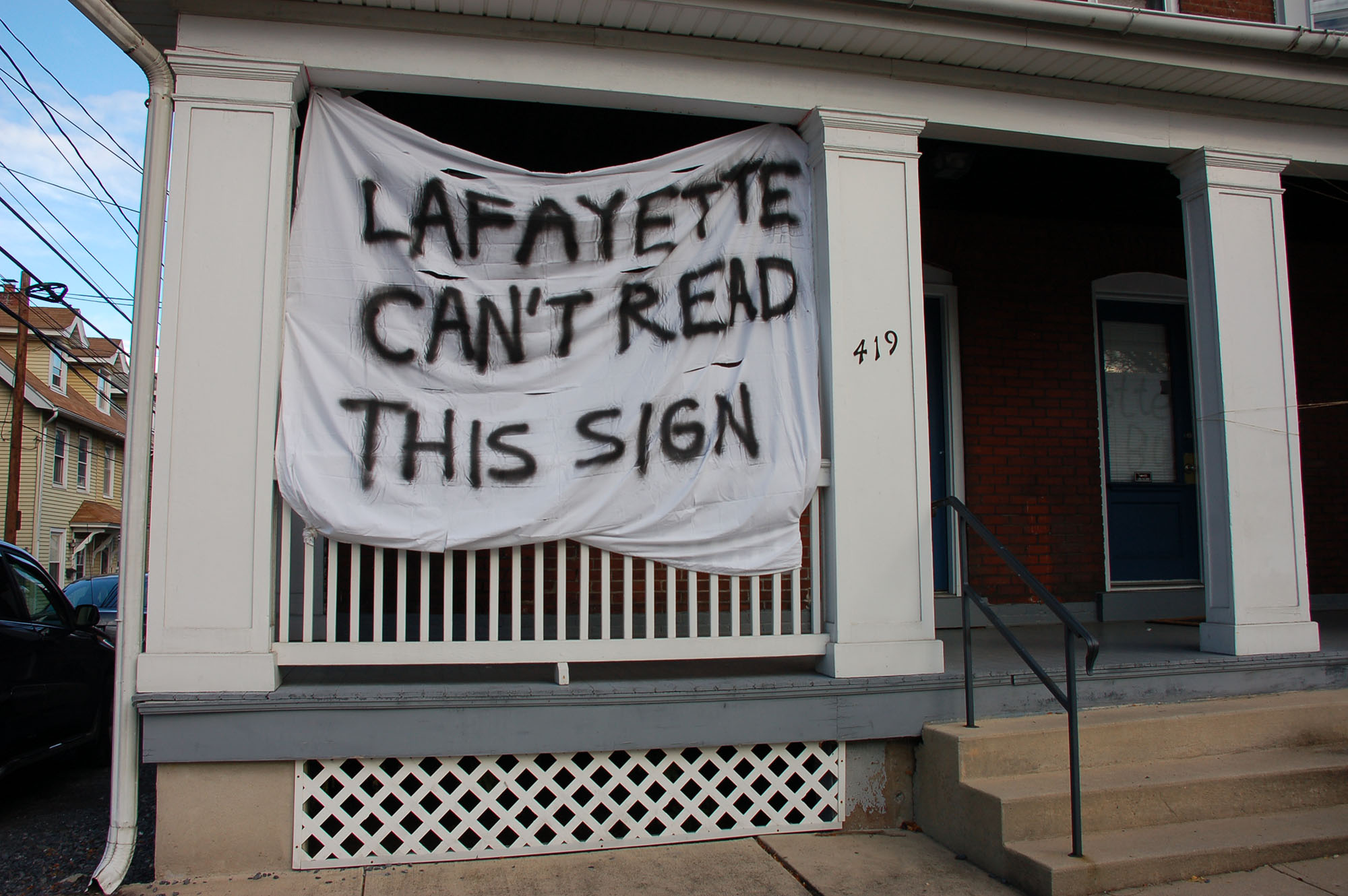 "A sign reading ""Lafayette can't read this sign"" hangs on a house on Webster Street on Nov. 15, 2016. Lehigh students hang these banners on their houses as part of spirit week. (Samantha Tomaszewski/B&W Staff)"