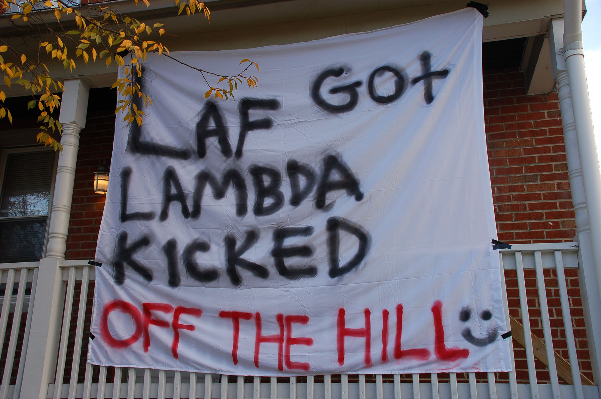 "A sign reading ""Laf got Lambda kicked off the Hill"" hangs on a house on East Fifth Street on Nov. 15, 2016. Lehigh-Lafayette week is celebrated by students every November. (Samantha Tomaszewski/B&W Staff)"