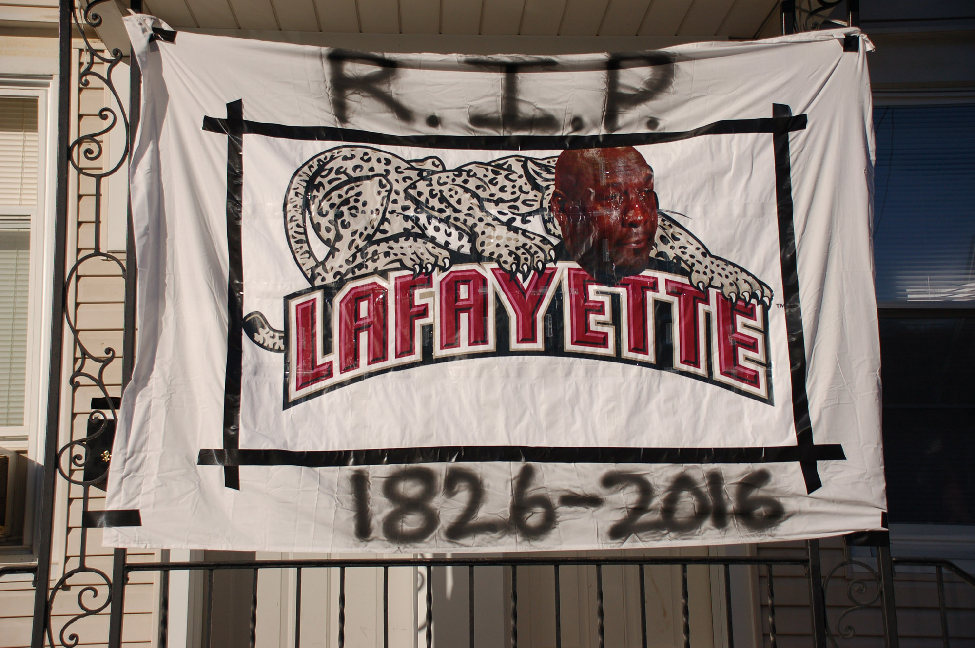 "A sign reading ""R.I.P Lafayette 1826-2016"" hangs on a house at East Fifth Street on Nov. 18, 2016. The crying Jordan is a popular meme on the internet. (Gaby Morera/B&W Staff)"