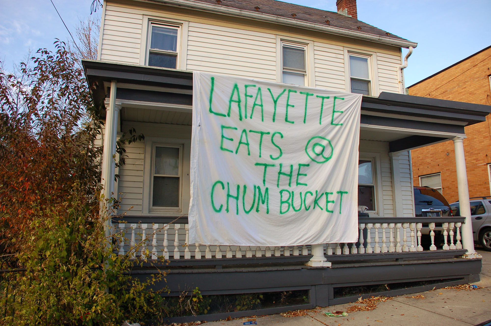 "A sign reading ""Lafayette eats at the Chum Bucket"" hangs on a house on East Fifth Street on Nov. 15, 2016. The sign is a reference to the television show ""Spongebob Squarepants."" (Samantha Tomaszewski/B&W Staff)"