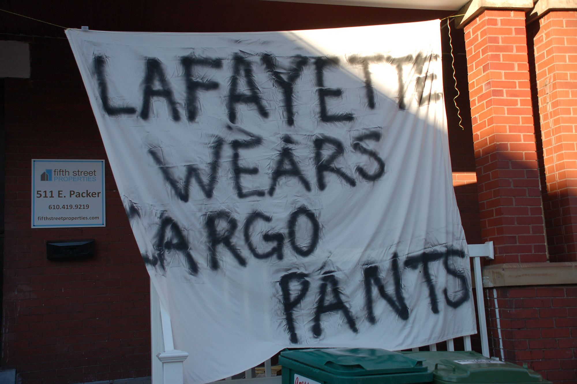 "A sign reading ""Lafayette wears cargo pants"" hangs on a house on East Packer Street on Nov. 18, 2016. Lehigh-Lafayette week is celebrated every year in November. (Gaby Morera/B&W Staff)"