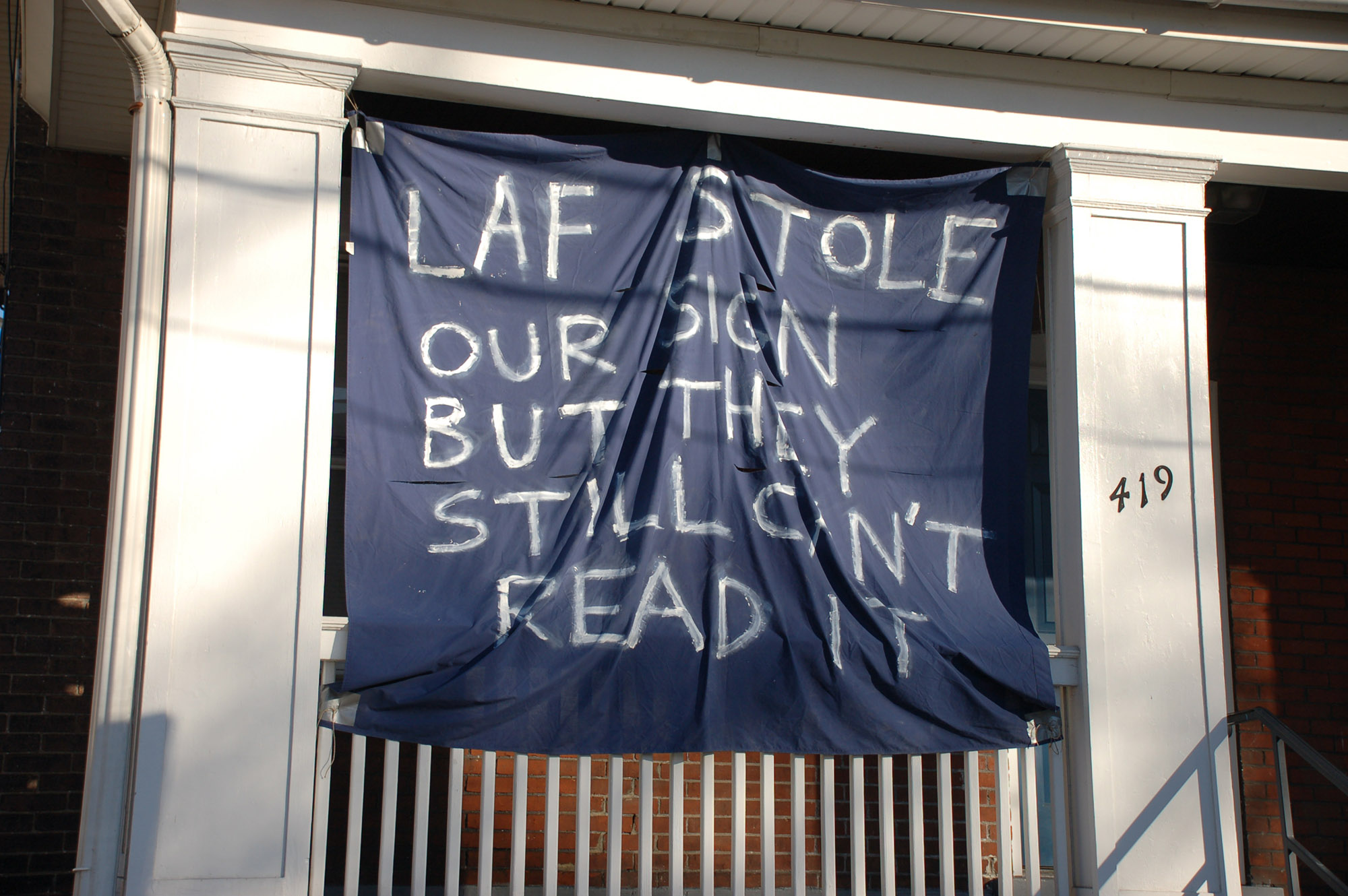 "A sign reading ""Laf stole our sign but they still can't read it"" hangs on a house on Webster Street on Nov. 18, 2016. The house's original sign read ""Lafayette can't read this sign."" (Gaby Morera/B&W Staff)"