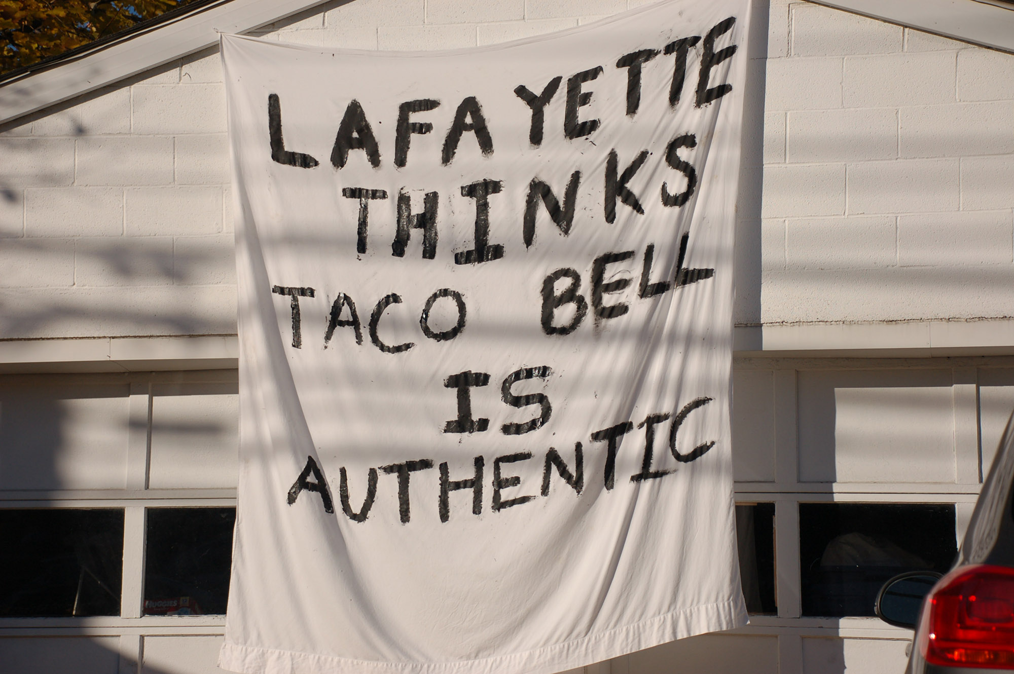 "A sign reading ""Lafayette thinks Taco Bell is authentic"" hangs on a garage on Morton Street on Nov. 18, 2016. Lehigh's rivalry football game is this Saturday. (Gaby Morera/B&W Staff)"