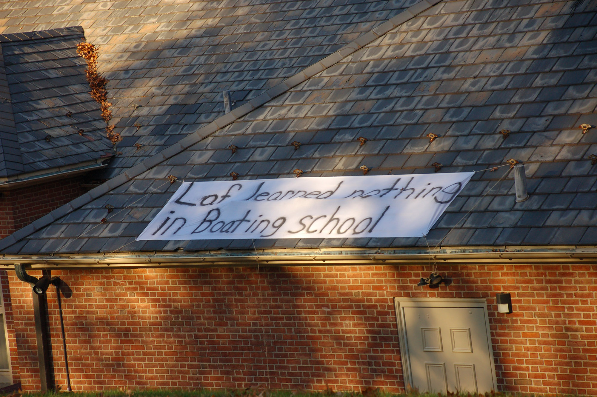 "A sign reading ""Laf learned nothing in boating school"" hangs on Delta Upsilon on Nov. 18, 2016. The sign is a reference to the television show ""Spongebob Squarepants."" (Gaby Morera/B&W Staff)"