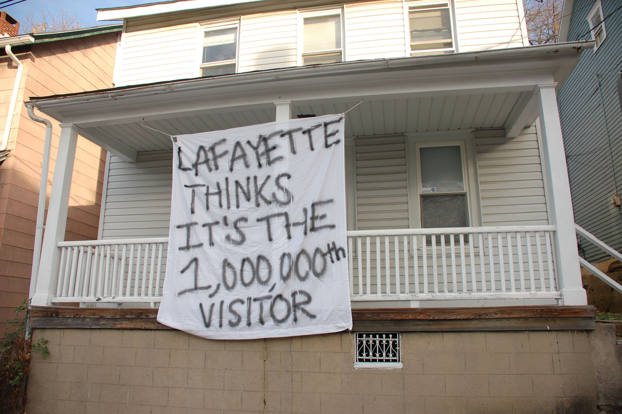 "A sign reading ""Lafayette thinks it's the 1,000,000th visitor"" hangs on a house on Montclair Avenue on Nov. 15, 2016. The tradition of hanging banners on off-campus houses has been present at Lehigh for many years. (Samantha Tomaszewski/B&W Staff)"