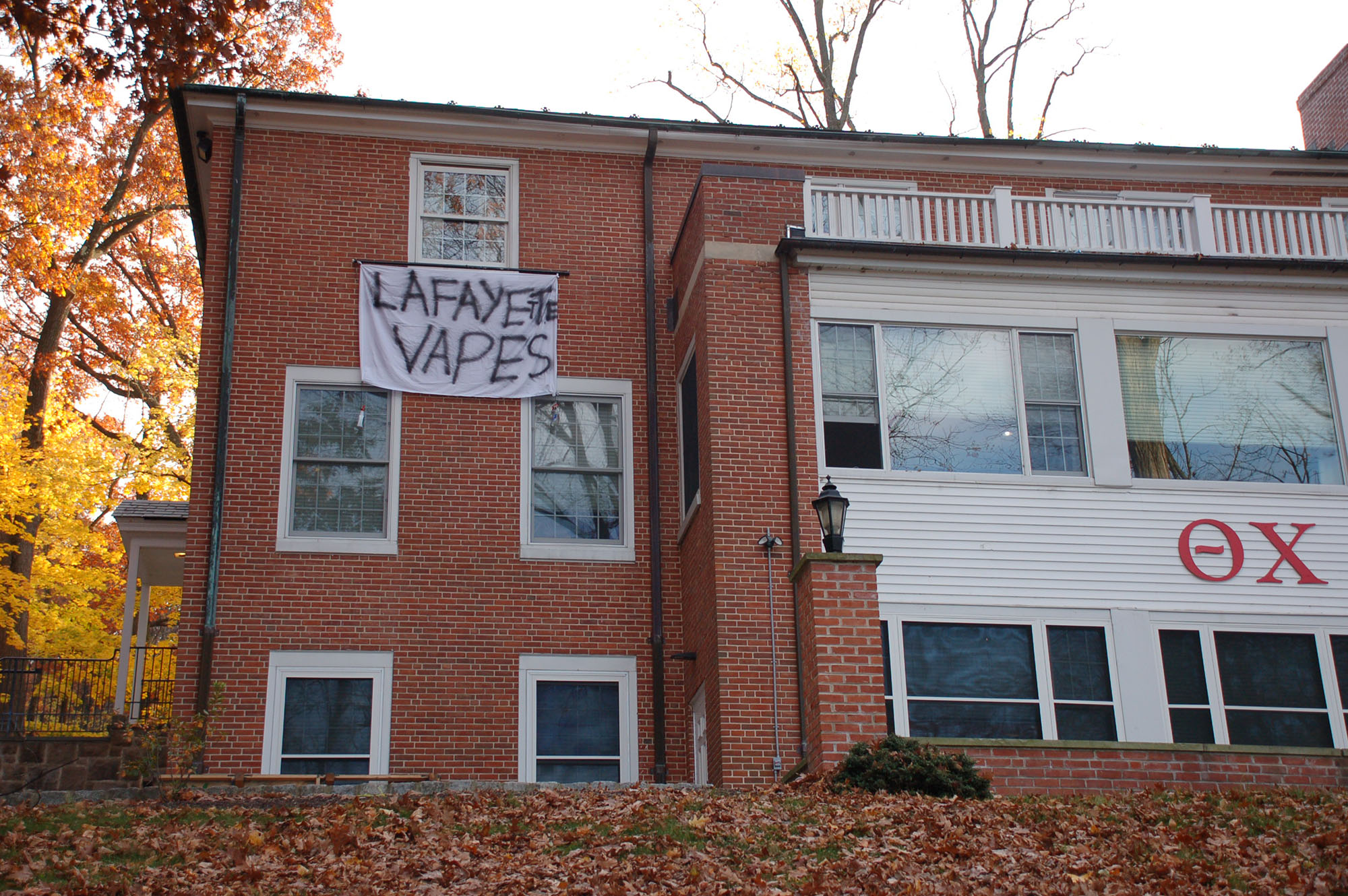 "A sign reading ""Lafayette vapes"" hangs on the Theta Chi fraternity house on Nov. 15, 2016. The banners are one of many campus spirit traditions that take place during Lehigh-Lafayette week. (Samantha Tomaszewski/B&W Staff)"
