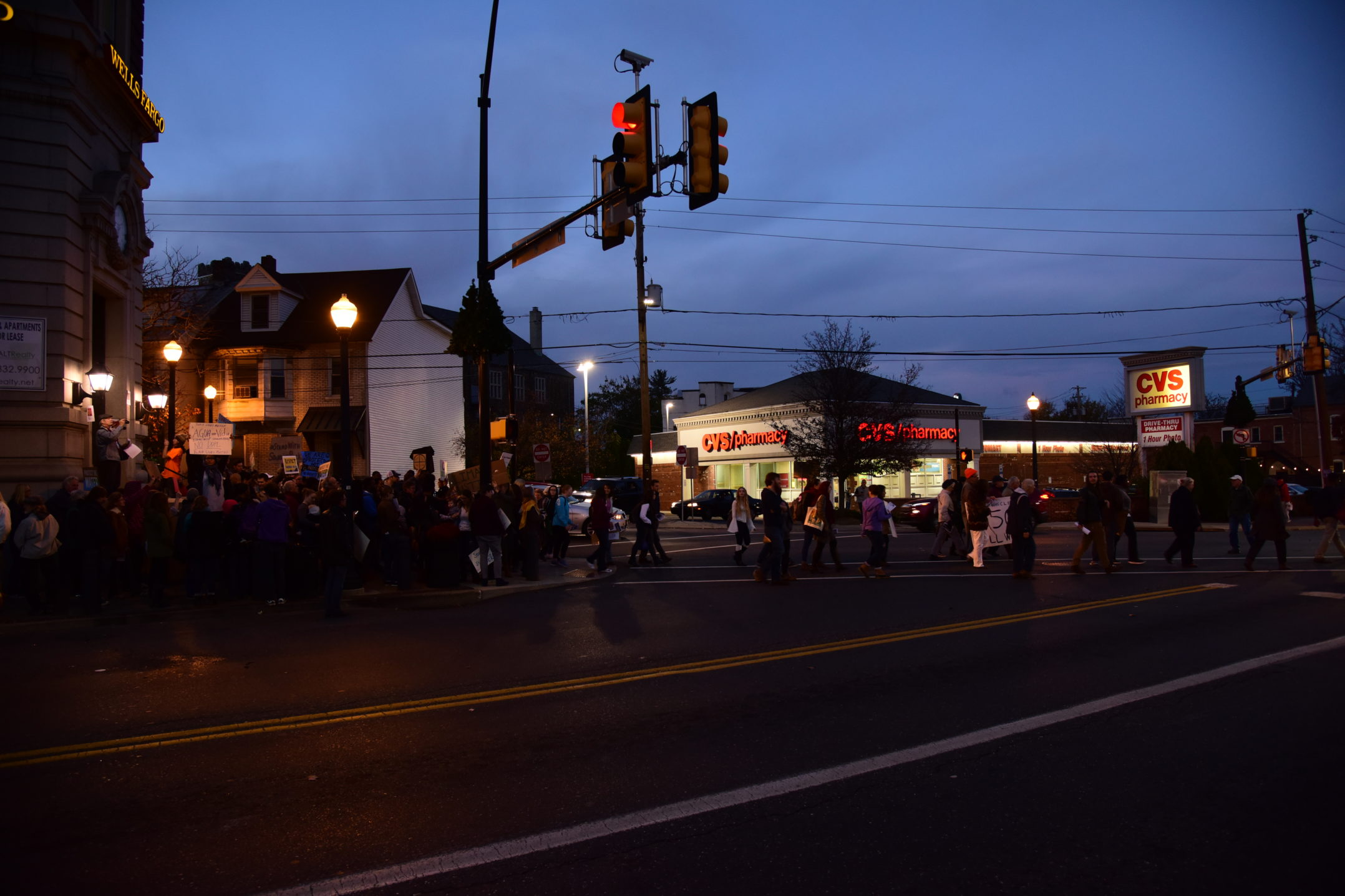The protesters cross the street. They are headed back to campus. (Ashley Omoma/B&W Staff)