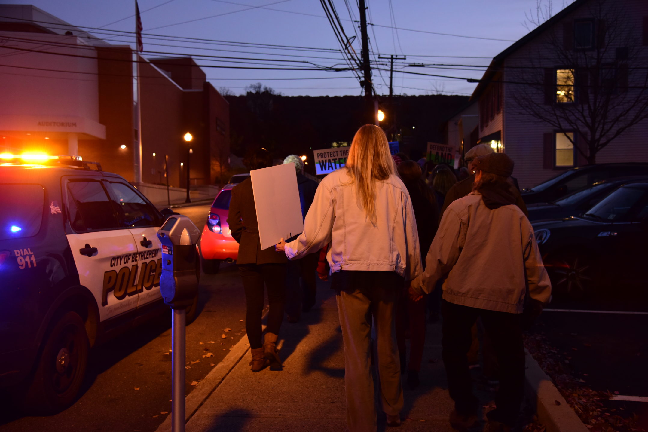 Protesters are briefly stopped by Bethlehem Police as they head back towards the flagpole. The police questioned organizers of the protest on what they were doing before allowing them to continue to campus. (Ashley Omoma/B&W Staff)