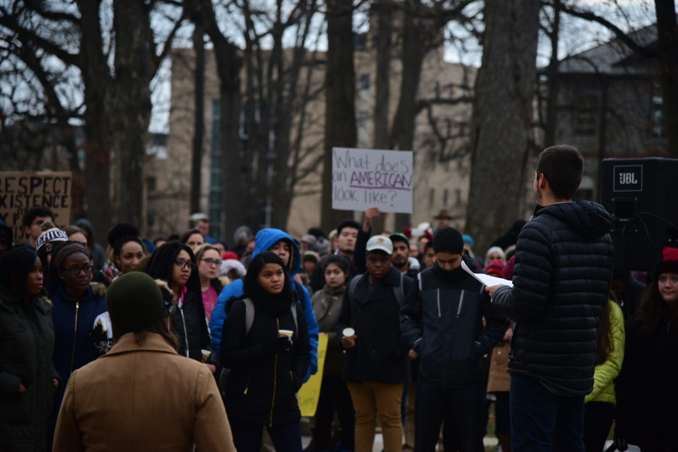 Members of the Lehigh community gather at the flagpole for a rally of solidarity. Juan Palacio Moreno talks to the crowd at the rally about his experiences as an immigrant. (Ashley Omoma/B&W Staff)