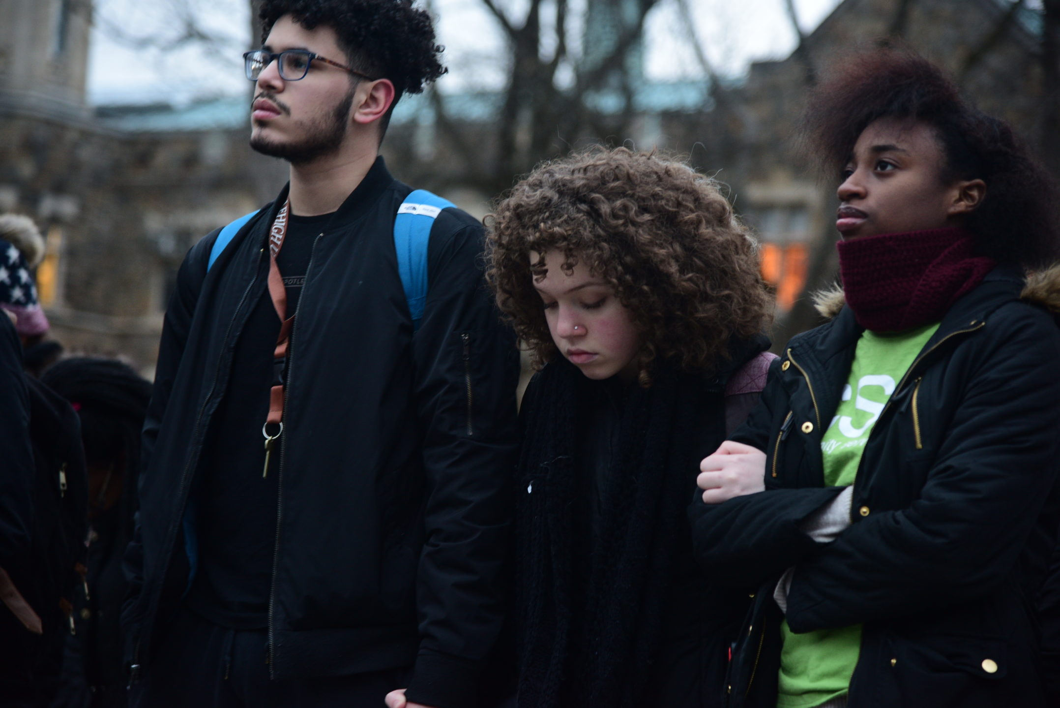 Martin Fernandez, '20, Massiel Checo, '20, and A'Taja Jackson listen to the speaker at the rally. During the rally members of the Lehigh community voiced their stories and opinions on immigration. (Ashley Omoma/B&W Staff)