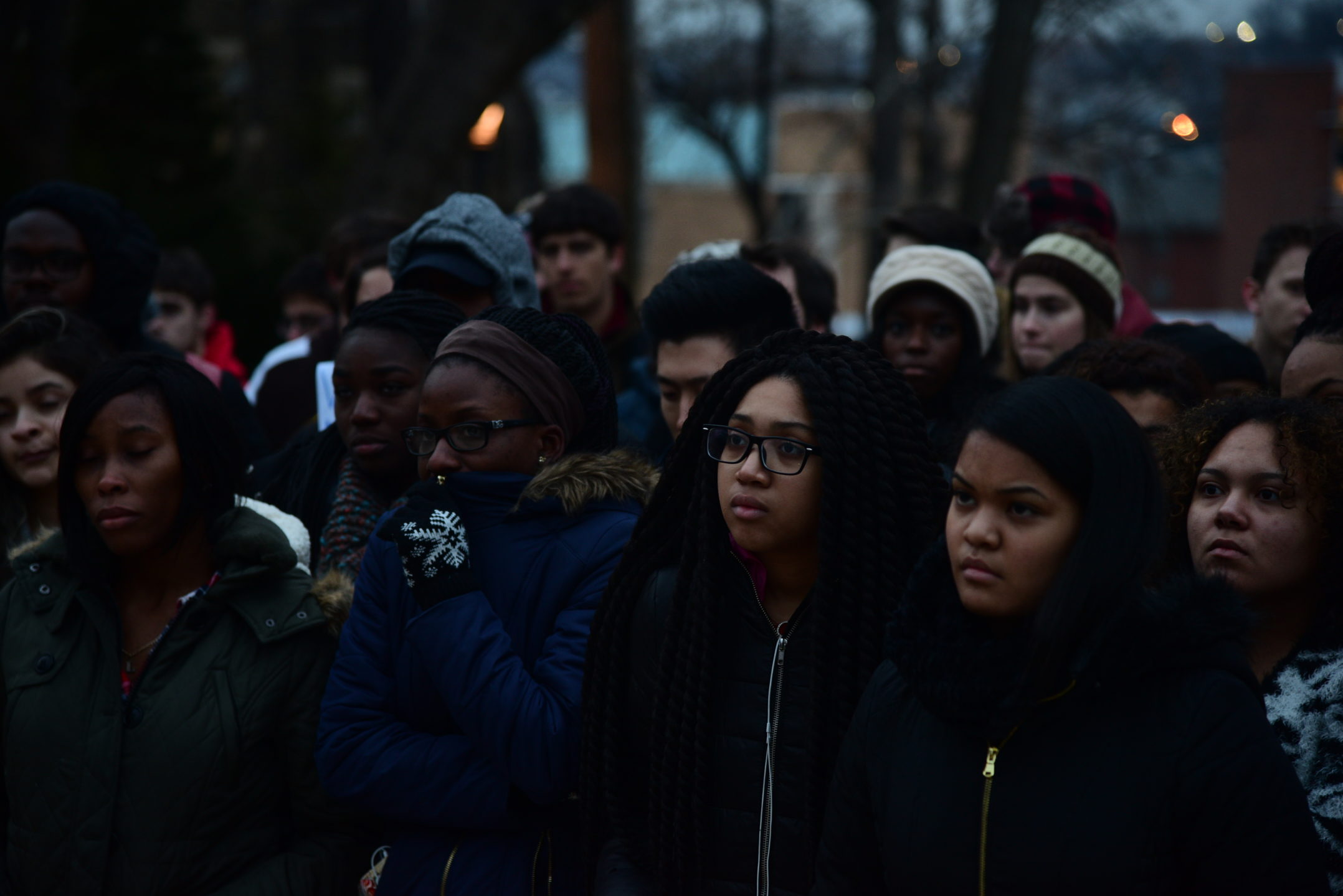 Lounie Germain, '20,  Kezia Ofosu-Oware, '20, Shanice Merteens, '20, Gaby Montes, '20, stand in silence at the rally. The four listen to David Kroll speak. (Ashley Omoma/B&W Staff)