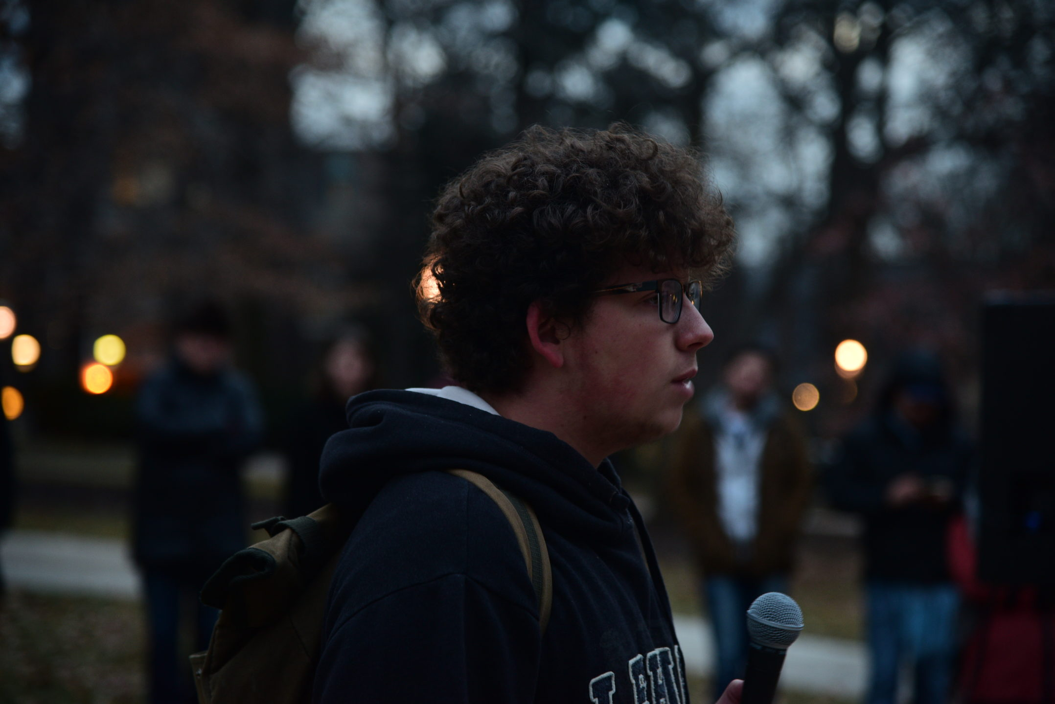 David Kroll, '20, spoke at the rally on his experience with the U.S. treatments of immigrants. He urges people to act and not be passive in the presence of injustice. (Ashley Omoma/B&W Staff)