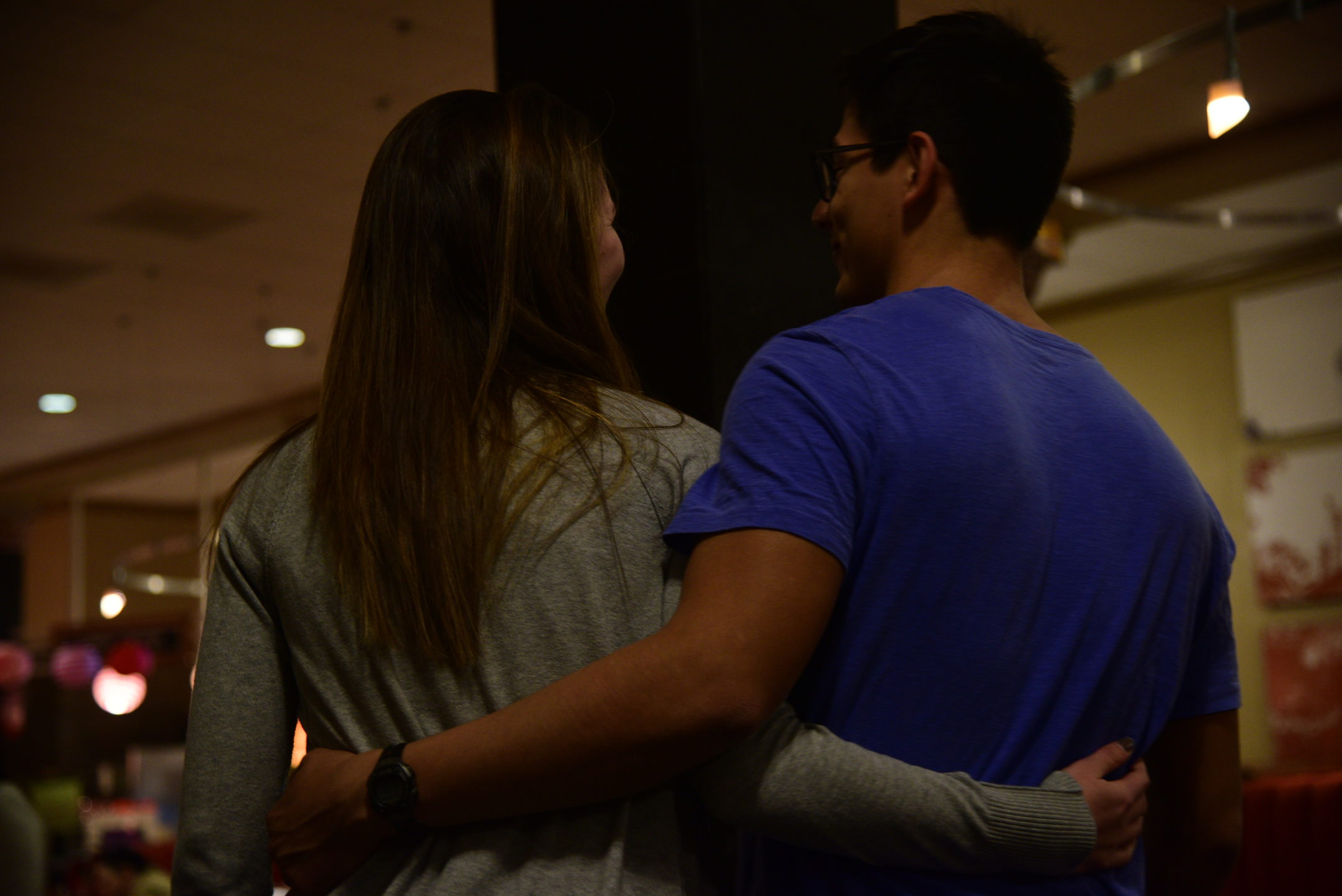 Kelli Barber, '18, and Carlos Chavez, '18, hold each other as they walk through Lower Cort dining hall. Lower Cort held a Valentine's Day theme dinner. (Ashley Omoma/B&W Staff)