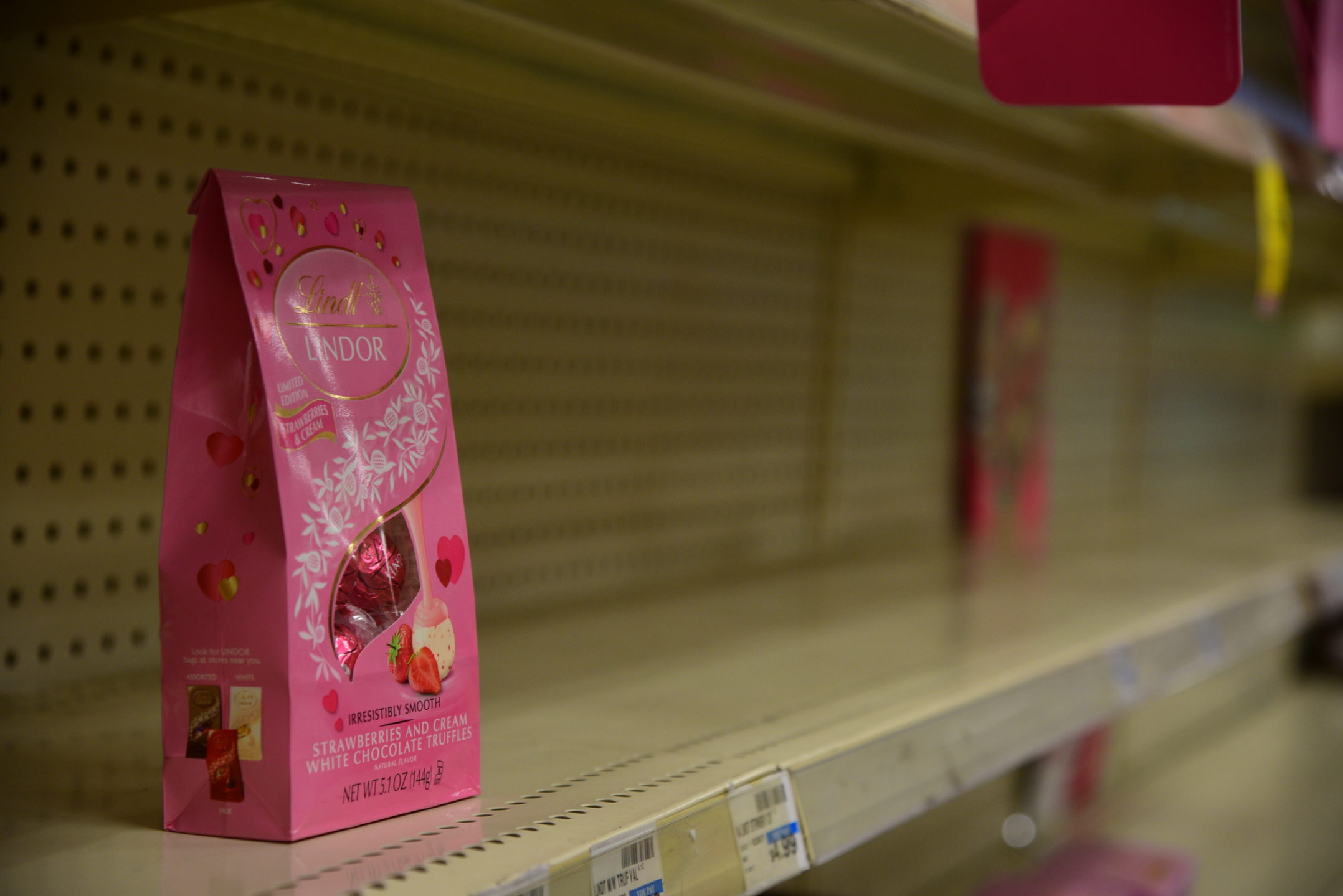 The last of the Valentine's Day treats sit on the shelves of CVS located at 305 W. Fourth St. as the night comes to an end. The Valentine's Day section of the store was almost completely emptied. (Ashley Omoma/B&W Staff)