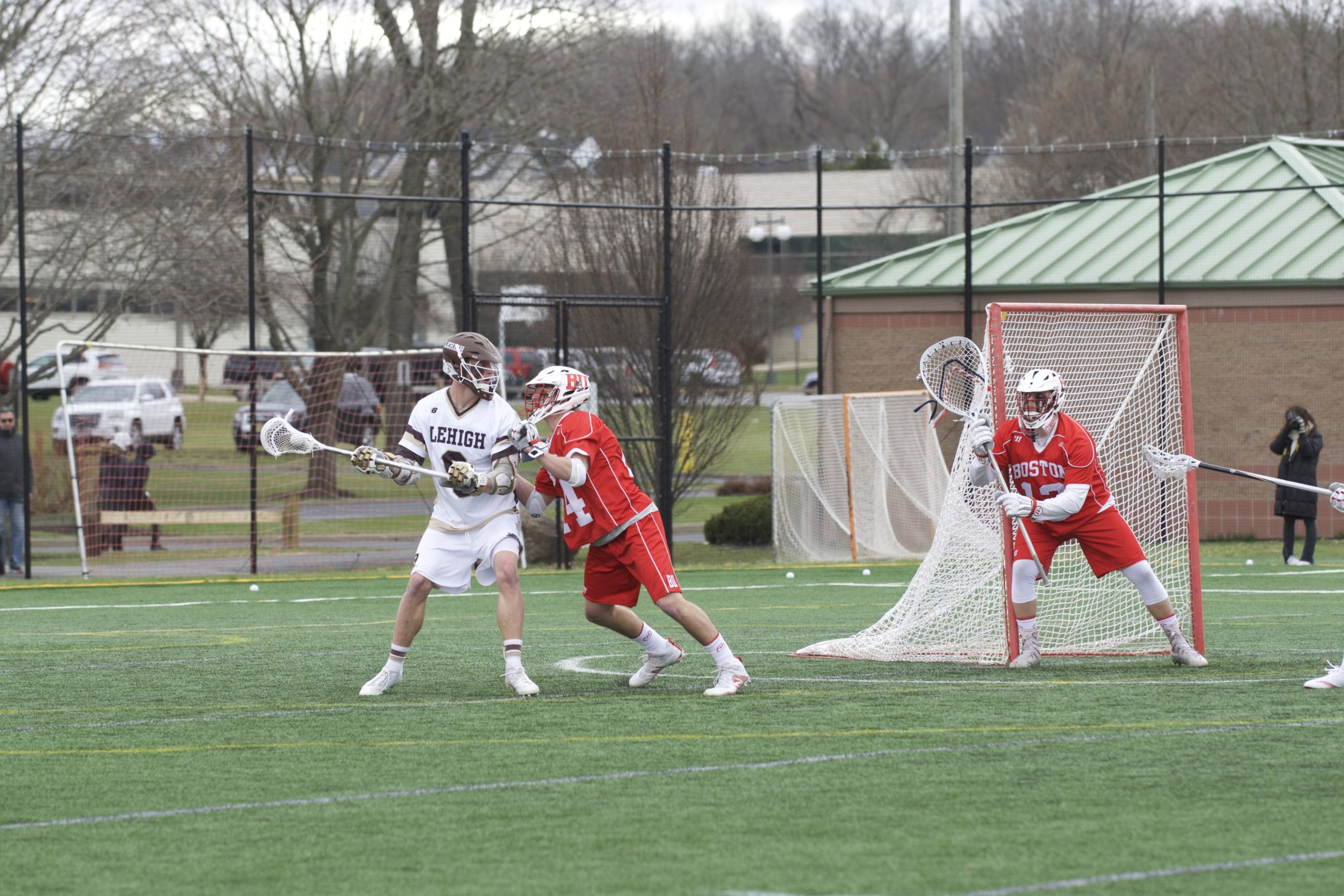 Lehigh sophomore attacker Mikey Fitzpatrick craddles the ball around the crease while being defended by Boston University freshman defender Chase Levesque during the men's lacrosse game versus Boston University on Saturday, April 1, 2017, at the Ulrich Sports Complex. Fitzpatrick had one shot on goal during the Mountain Hawks' 10-6 win. (Sarah Epstein/B&W Staff)