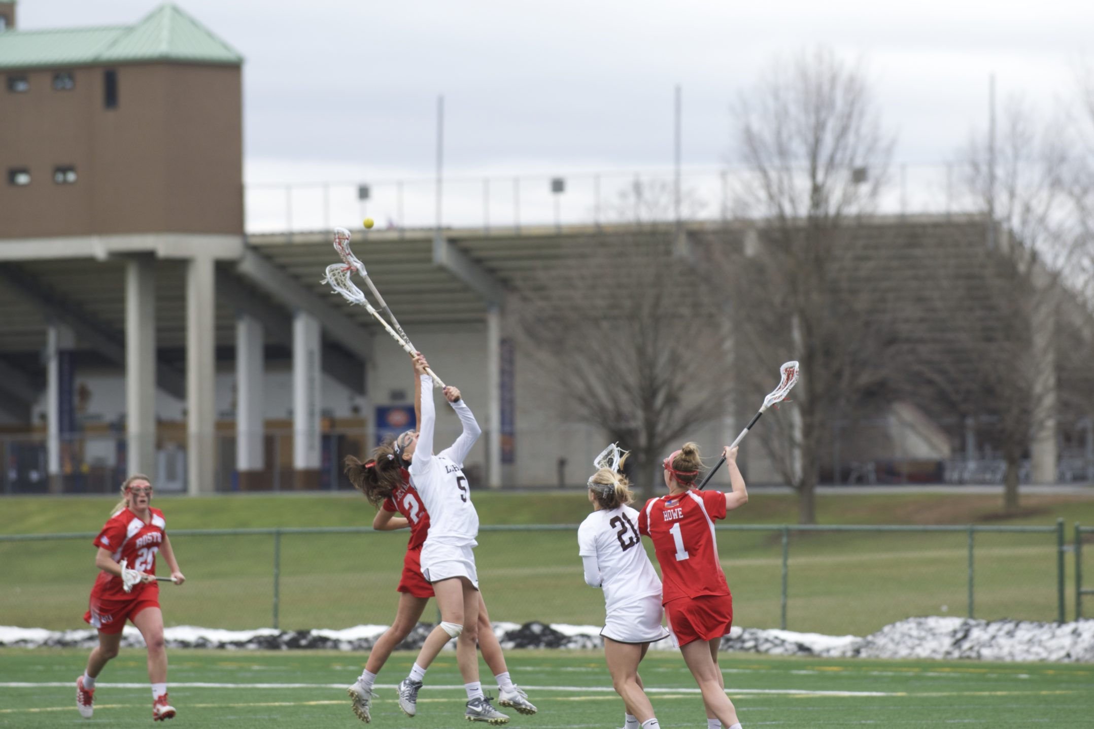 Lehigh senior midfielder Lauren Beausoleil goes up for a draw control against Boston University sophomore midfielder Katie Belval on Saturday, April 1, 2017, at Ulrich Sports Complex. Beausoleil had two draw controls during the Mountain Hawks' 13-12 win over the Terriers. (Sarah Epstein/B&W Staff)