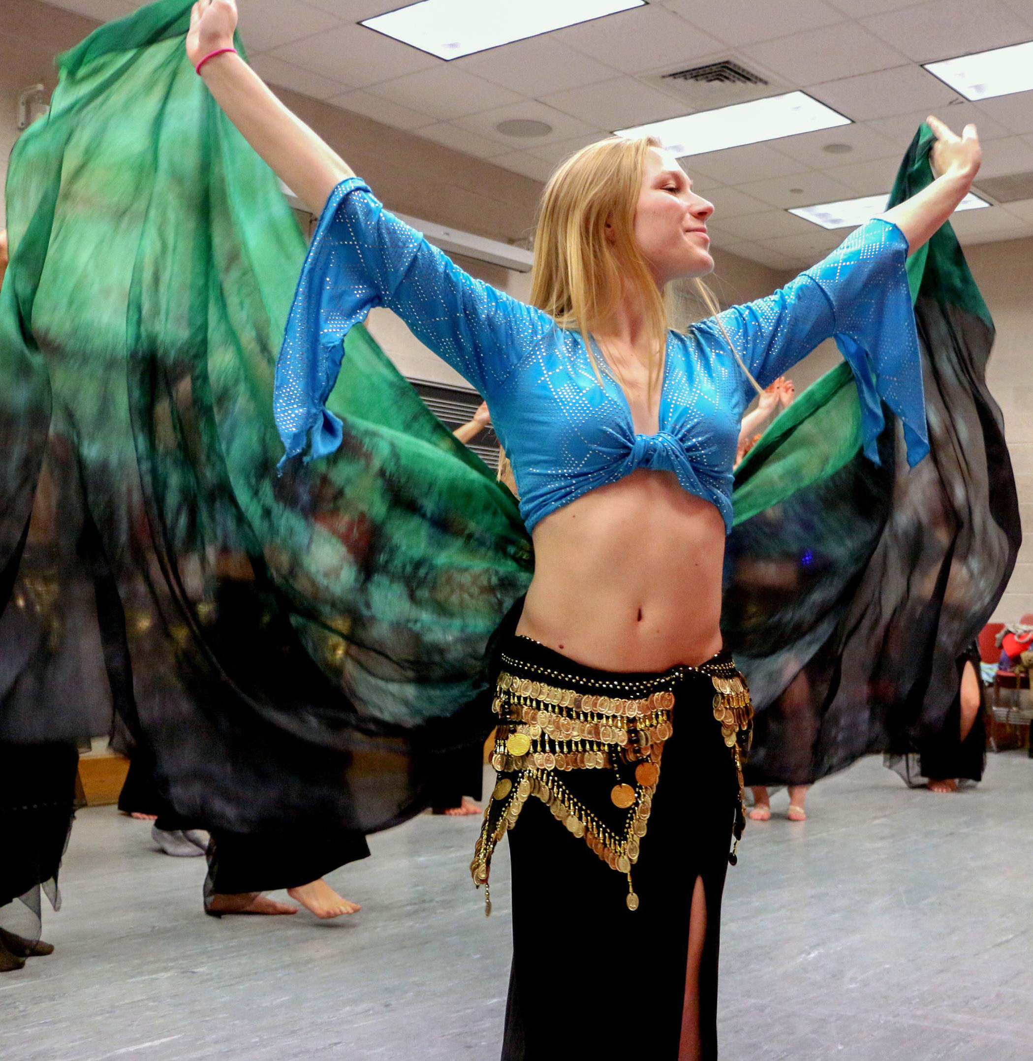 Belly dancer Natalie Seifert, '18, practices her twirls with a flowy shawl on Nov. 7, 2016 at Zoellner Arts Center. Seifert's added accessories helped accentuate her dance solo. (Lauryn Ragone/B&W Staff)