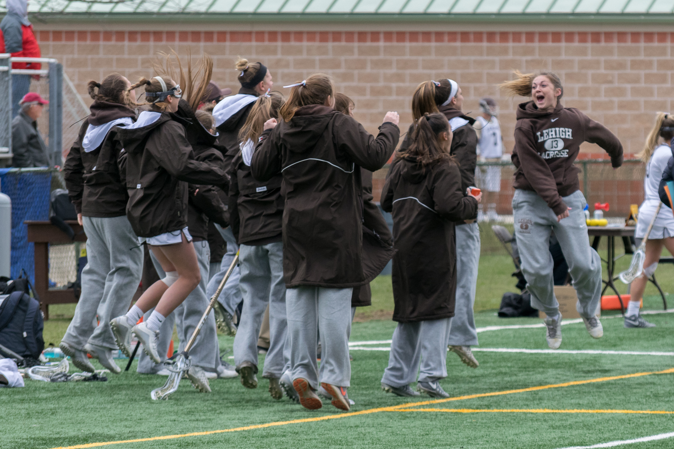 The women's lacrosse team celebrates after their 13-12 victory over Boston University on Saturday, April 1, 2017, on Banko Field. Lehigh held off BU's attempt to tie the game in the last 30 seconds. (Roshan Giyanani/B&W Staff)