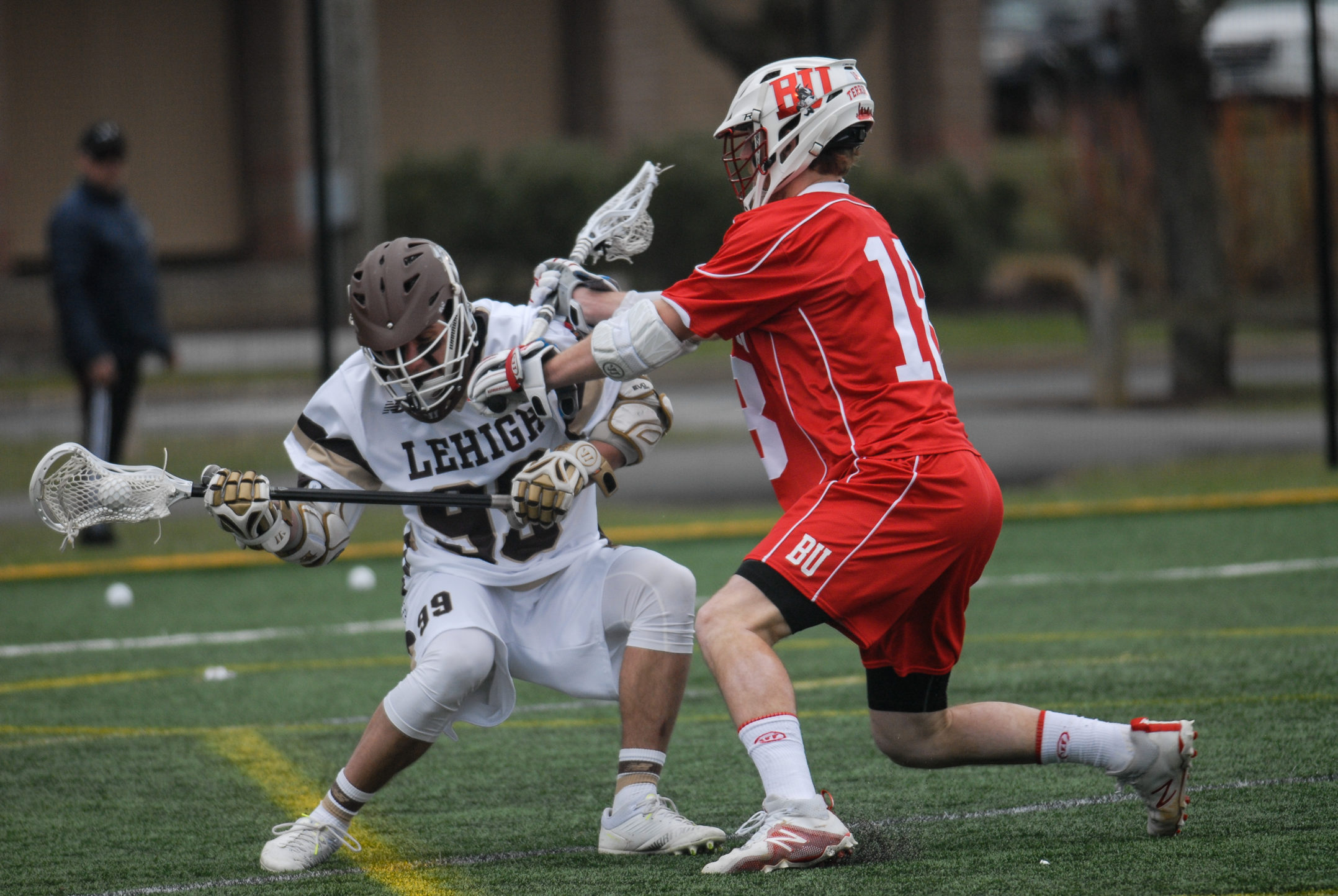 Sophomore midfielder Lucas Spence gets checked by Boston University senior midfielder Jack Beall during their game on Saturday, April 1, 2017, at the Ulrich Sports Complex. Spence had one assist and two shots on goal during the game. (Erik Thomas/B&W Staff)
