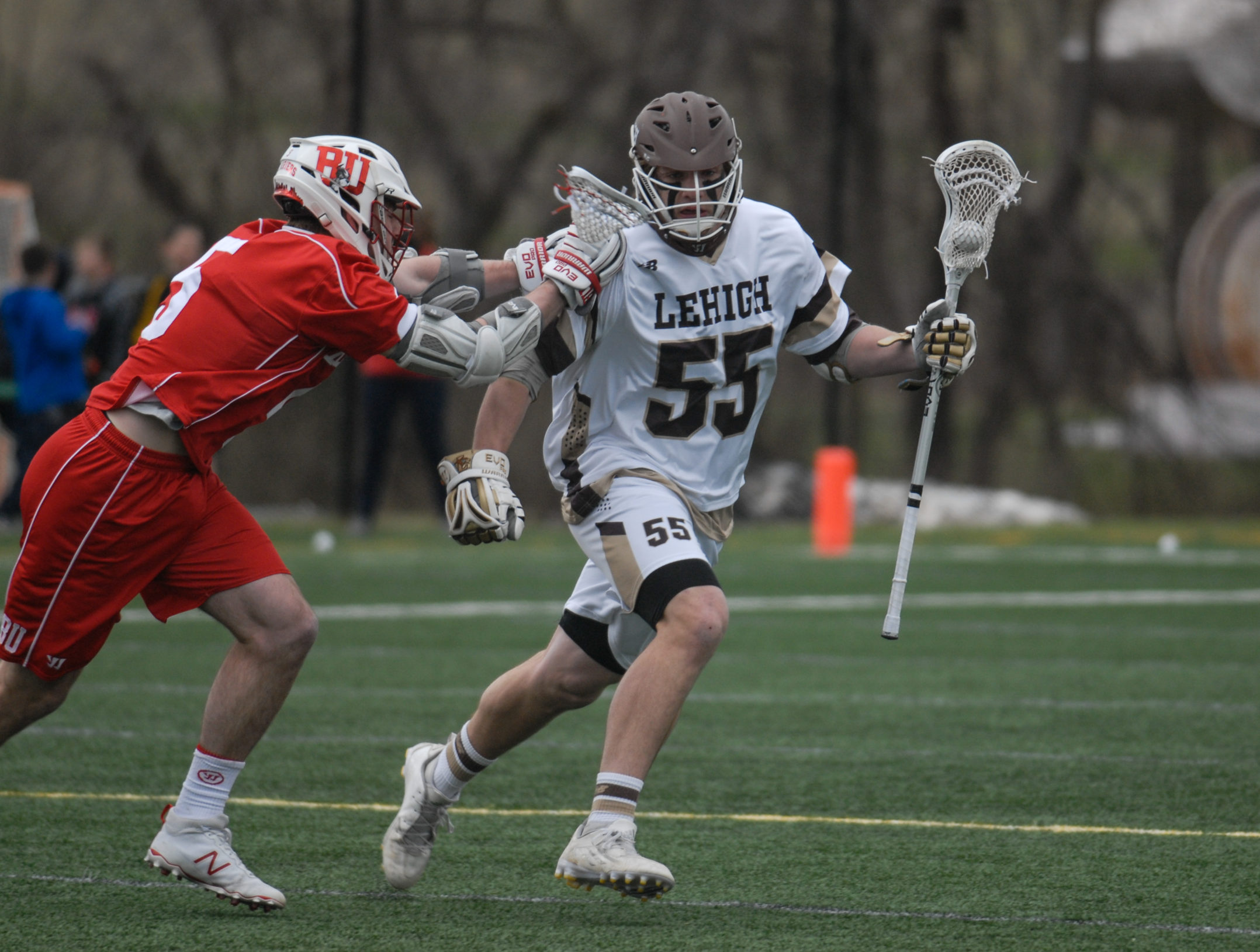 Lehigh freshmen midfielder Andrew Eichelberger tries to avoid a check during Lehigh's game against Boston University on Saturday, April 1, 2017, at the Ulrich Sports Complex. Lehigh won with a final score of 10-6. (Erik Thomas/B&W Staff)