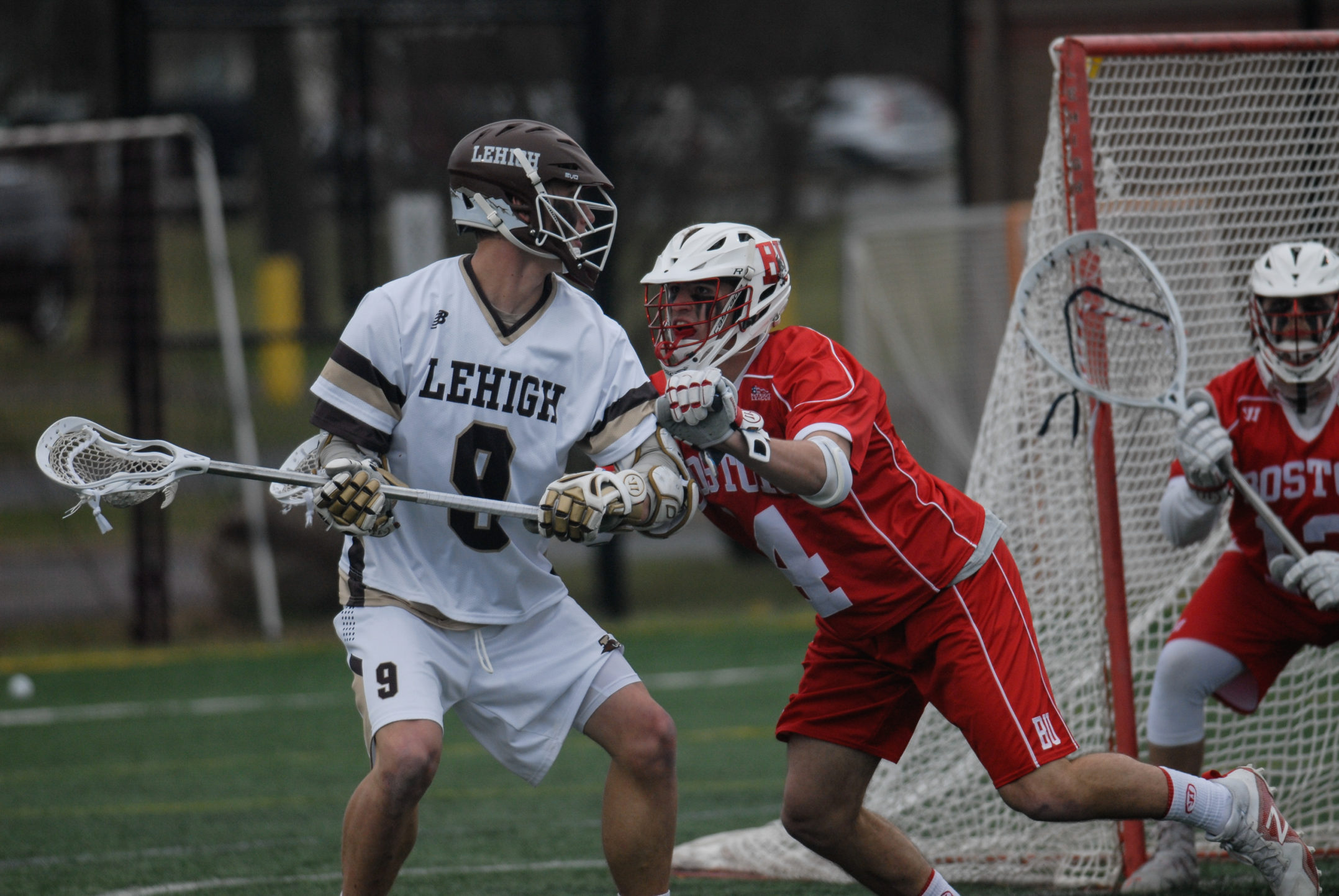 Senior attacker Matt Raposo looks to take a shot around Boston University senior midfielder Brian Badgett during their game on Saturday, April 1, 2017, at the Ulrich Sports Complex. Raposo had two goals and one assist on five shots during the game. (Erik Thomas/B&W Staff)