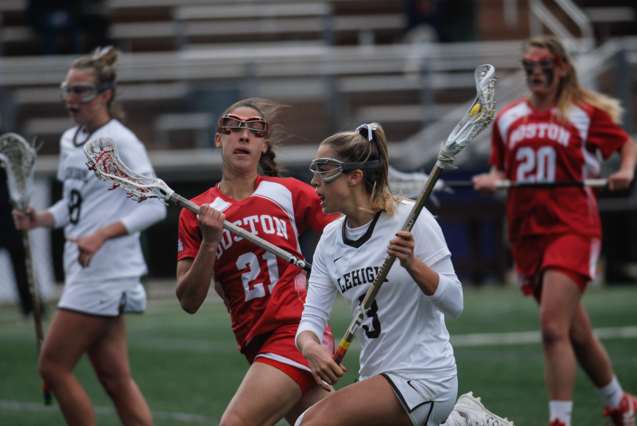 Junior attacker Haley Wentzel drives the ball past Boston University sophomore defensemen Tonianne Magnelli during Lehigh's game against Boston University on Saturday, April 1, 2017, at the Ulrich Sports Complex. Wentzel had one goal during the game. (Erik Thomas/B&W Staff)