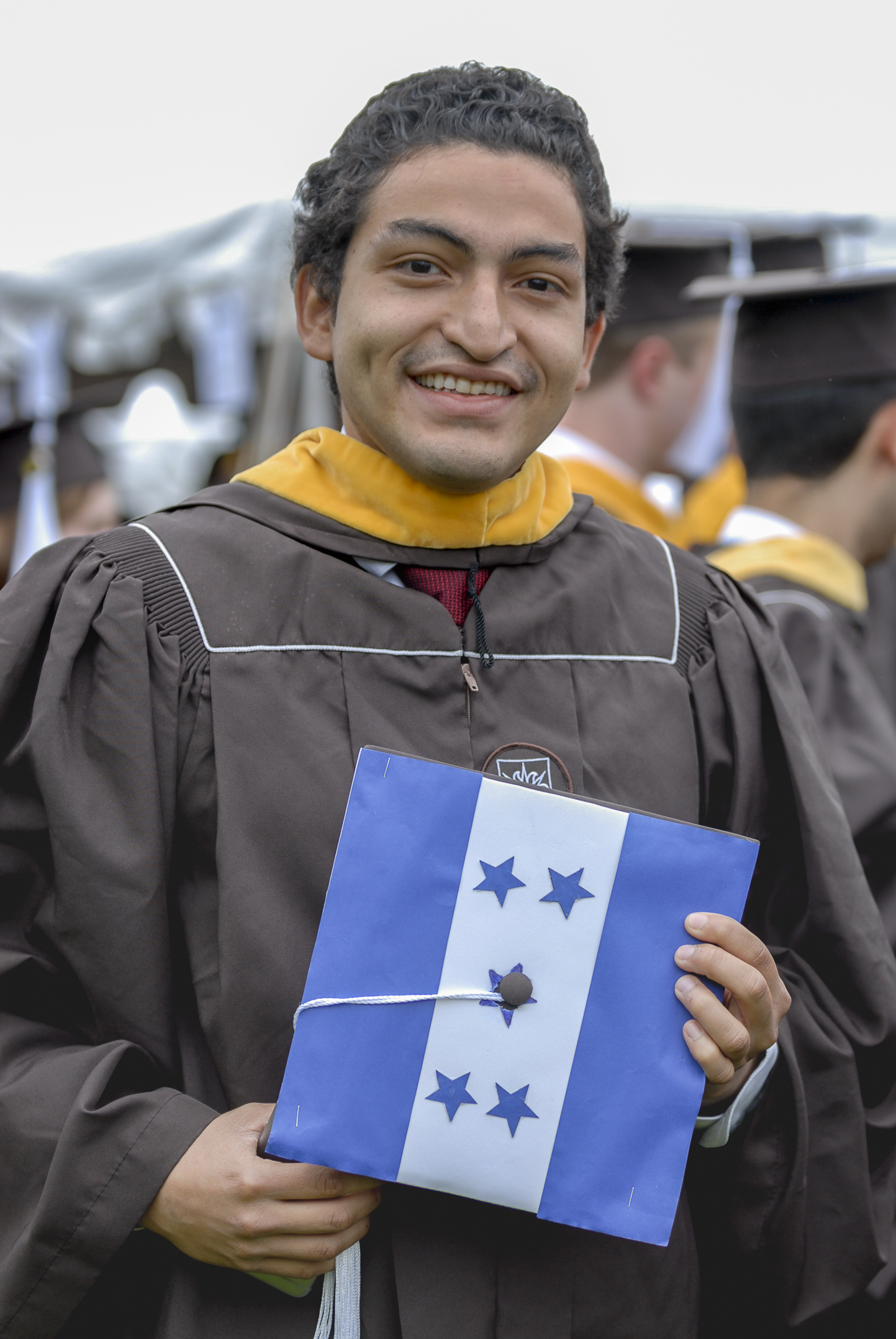 Alejandro Castro, '17, holds his graduation cap Monday, May 22, 2017, outside Goodman Stadium. Castro, an industrial and systems engineering graduate, decorated his cap with the Honduras flag to show pride for his home country. (Roshan Giyanani/B&W Staff)