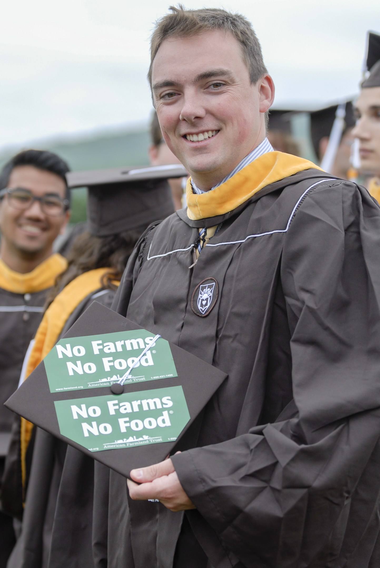 Kenneth Kinsman, '17, holds his graduation cap Monday, May 22, 2017, outside Goodman Stadium. A mechanical engineering graduate, Kinsman's family owns a farm. (Roshan Giyanani/B&W Staff)