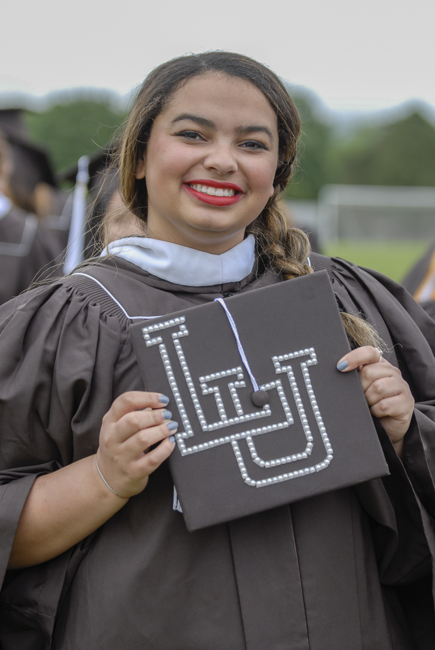 "Danielle Joy, '17, holds her graduation cap Monday, May 22, 2017, outside Goodman Stadium. Joy, an international relations graduate, decorated her hat with the letters ""LU"" to show her Lehigh pride. (Roshan Giyanani/B&W Staff)"