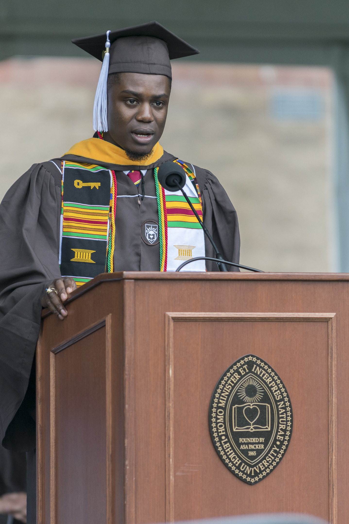 "Frederick Coleman, '17, speaks as the president of the class of 2017 on Monday, May 22, 2017, in Goodman Stadium. Coleman, a business information systems graduate, told the audience ""diversity and opportunity can walk hand-in-hand."" (Roshan Giyanani/B&W Staff)"