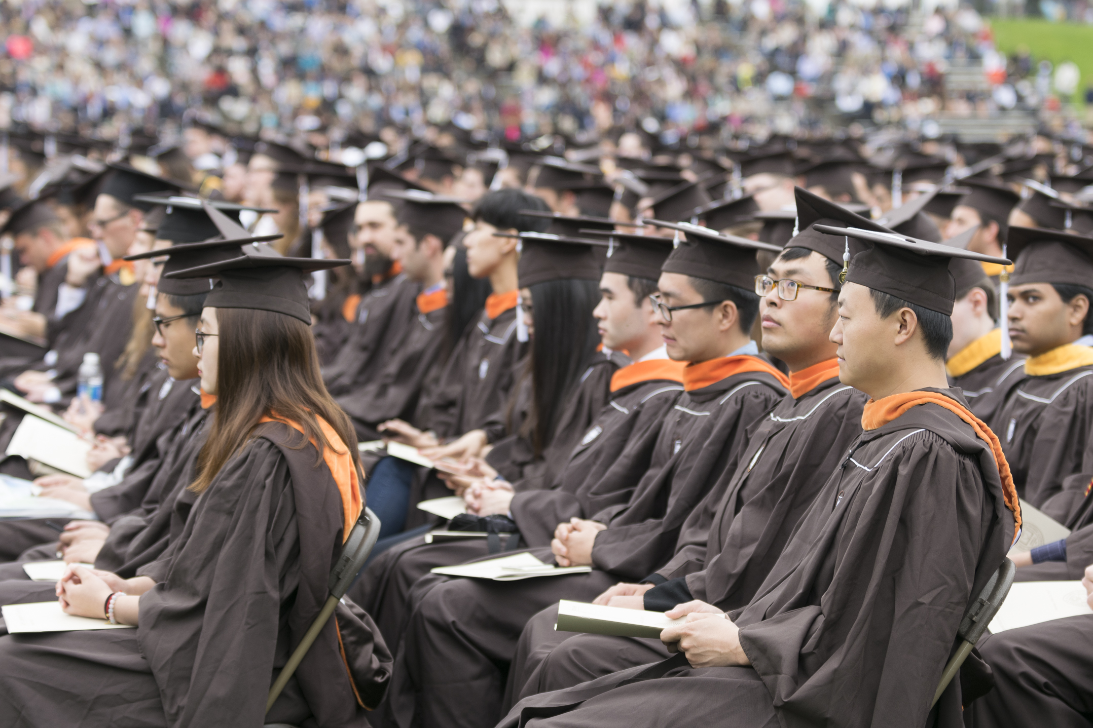 Graduates watch the commencement ceremony from their seats Monday, May 22, 2017, in Goodman Stadium. During President John Simon's address, he said the most popular major among the class of 2017 was finance, followed by mechanical engineering. (Roshan Giyanani/B&W Staff)