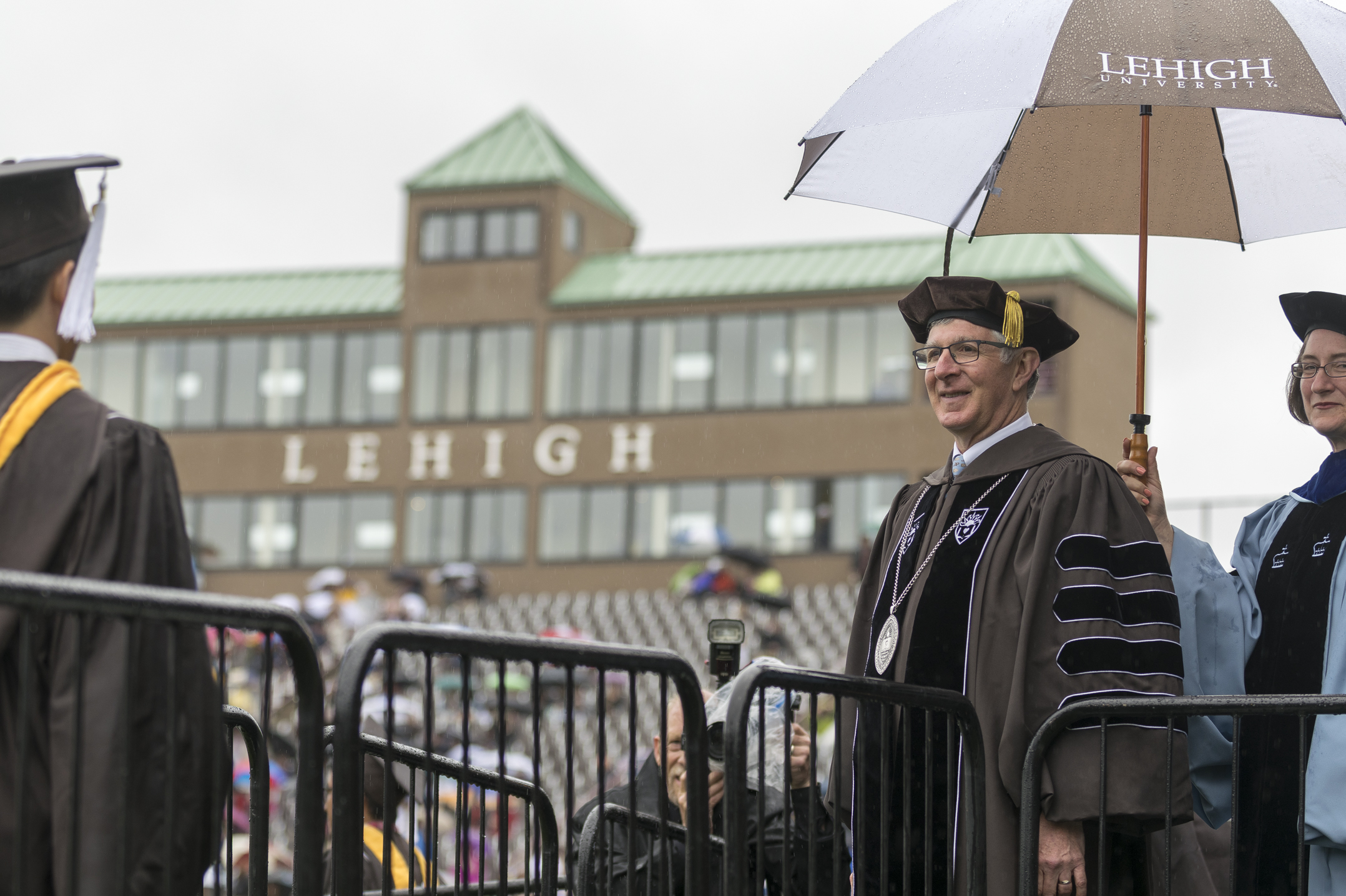 "President John Simon waits to shake the hands of graduates Monday, May 22, 2017, in Goodman Stadium. During his address, Simon said the class of 2017 undergraduate students pursued 61 different majors, ""a true reflection of the broad intellectual engagement of your class."" (Roshan Giyanani/B&W Staff)"