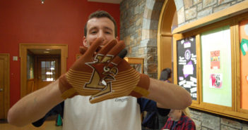 Mark Schatzman, '17, shows off the spirit gloves the class officers sold last November to promote Lehigh-Lafayette spirit week on Monday, Nov. 14, 2016. Last semester the Lehigh Fund discontinued the class officers program, which aimed to solicit donations from Lehigh students. (Kate Morrell/B&W Staff)