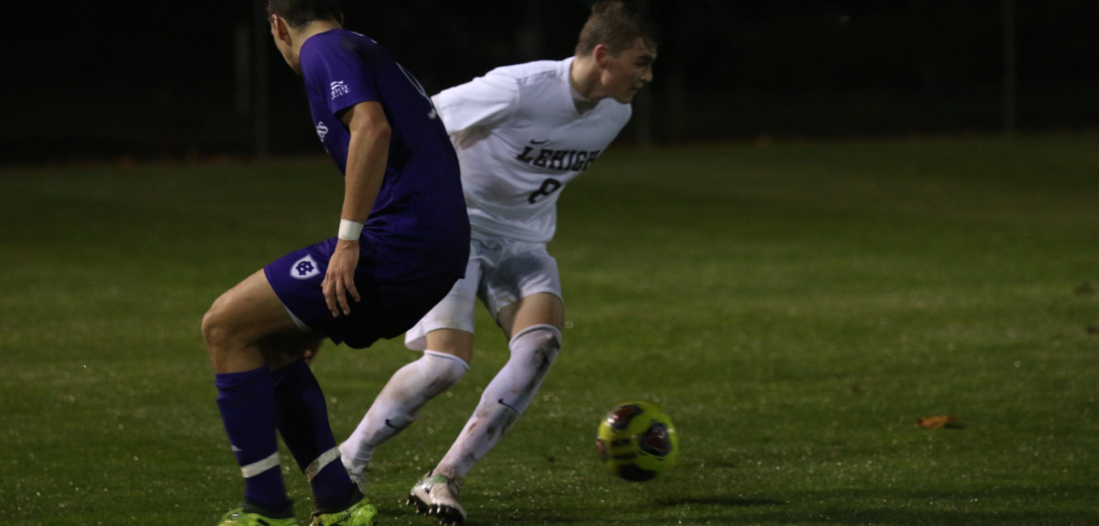 Freshman midfielder Stevo Benarsky wins the ball from Holy cross at the Patriot League quarterfinal game against Holy Cross at Ulrich Sports Complex on Tuesday night.  Bednarsky has been a key player for the Mountain Hawks all season.  (Alexis McGowan/ B&W Staff)