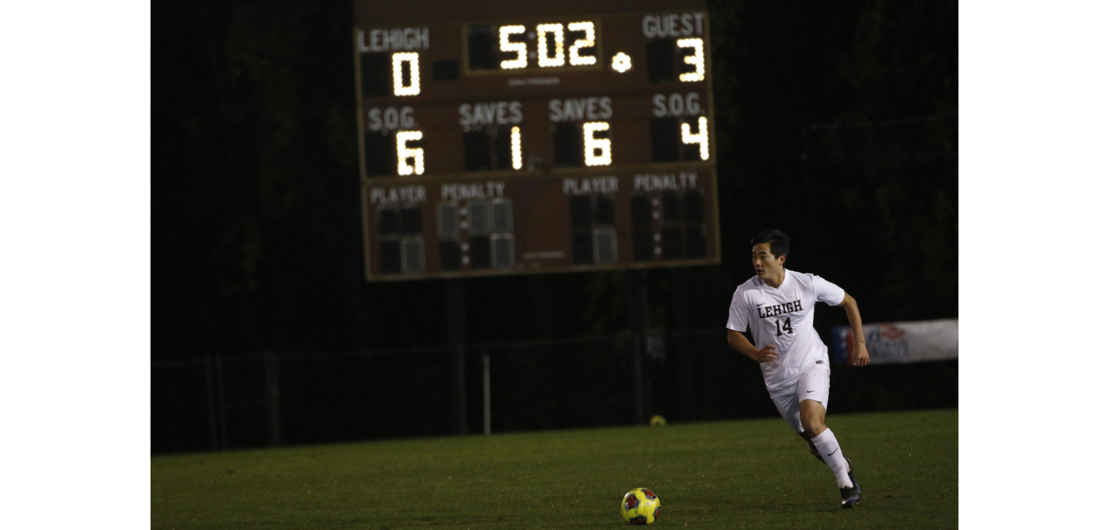 Senior midfielder Tatsu Otani forces the ball up the line during the final minutes of the Patriot League quarterfinal game against Holy Cross at Ulrich Sports Complex on Tuesday night. The Mountain Hawks fought hard until the last second but the game ended in a 3-0 loss for Lehigh. (Alexis McGowan/ B&W Staff)