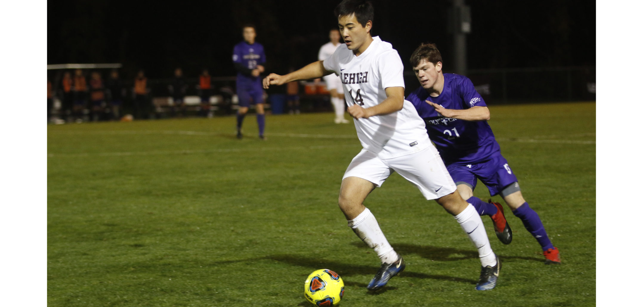 Senior midfielder Tatsu Otani is attacked from behind during the Patriot League quarterfinal game against Holy Cross at Ulrich Sports Complex on Tuesday night. Lehigh lost in a 3-0 shutout. All the goals were scored in the first 12 minutes of the game. (Alexis McGowan/ B&W Staff)