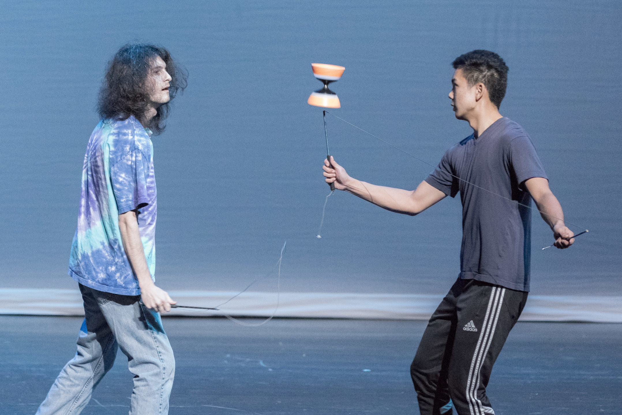 Allen Chan, '18, and Brian Bell, '17, pass a Chinese yoyo to one another on Thursday, Nov. 12, 2017, in Zoellner Arts Center. Chan has performed at Fusion in the past. (Roshan Giyanani/B&W Staff)