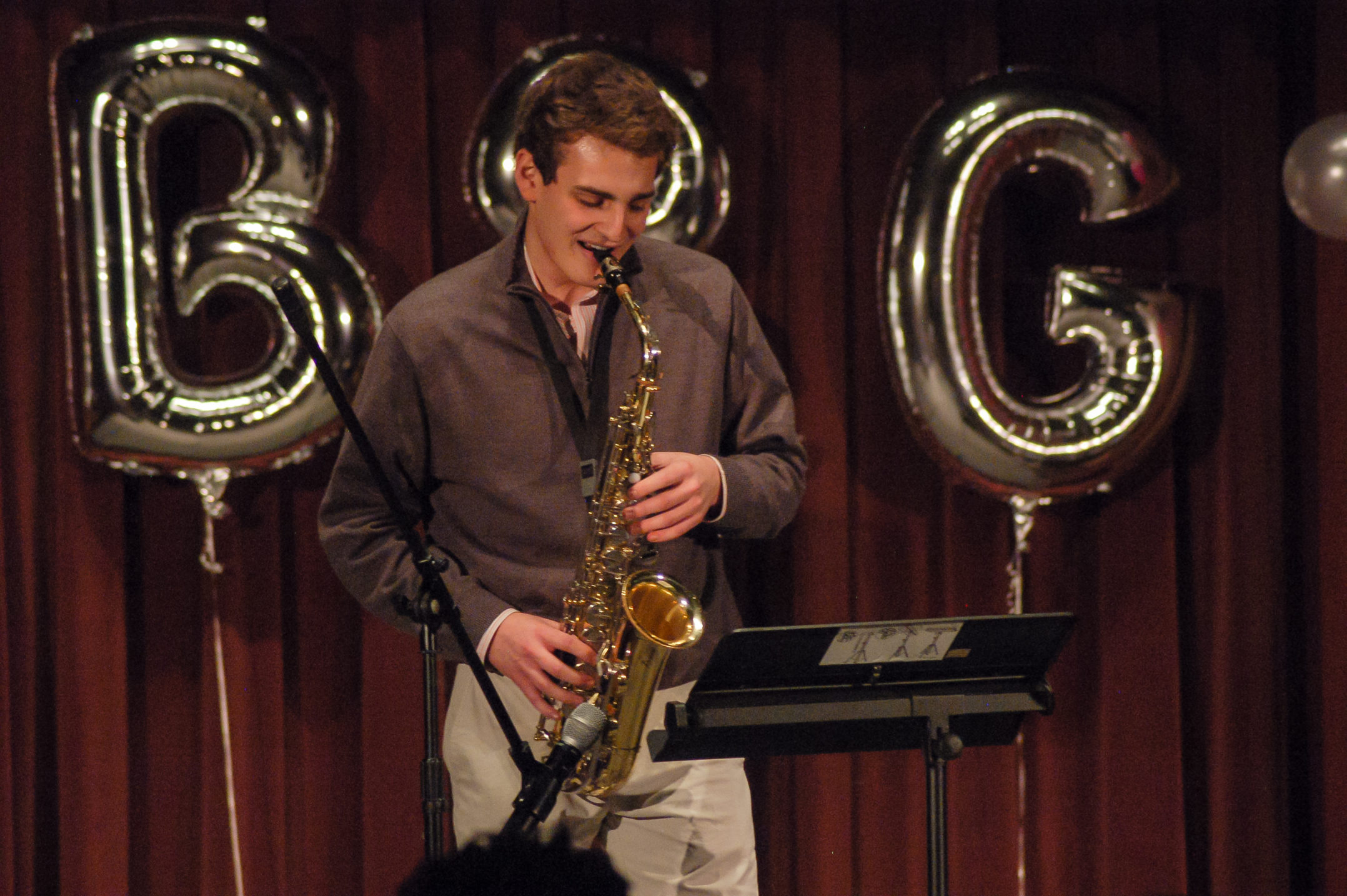 Ian Davis, '18, plays his saxophone for the talent portion of the Mr. Burgundy and Grey competition Saturday, Dec. 2, 2017, in Lamberton Hall. Later in the night, Davis was crowned Mr. Burgundy and Grey. (Alice Wilson/ B&W Staff)