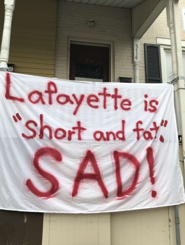 "A banner reading ""Lafayette is 'short and fat.' Sad!"" hangs outside a house near Lehigh's campus on Wednesday, Nov. 15, 2017. The sign references President Trump's Nov. 11 tweet directed toward Kim Jong-un. (Annie Henry/B&W Staff)"