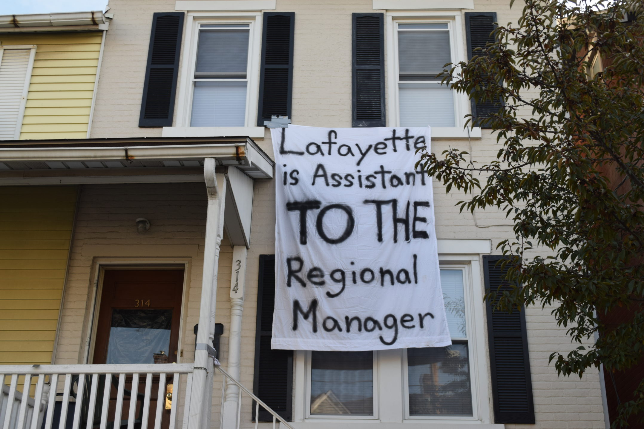 "A sign reading ""Lafayette is assistant to the regional manager"" hangs from a home on E. Fifth Street on Wednesday, Nov. 15, 2017. The sign is referencing popular television show ""The Office"". (Kate Morrell/B&W Staff)"