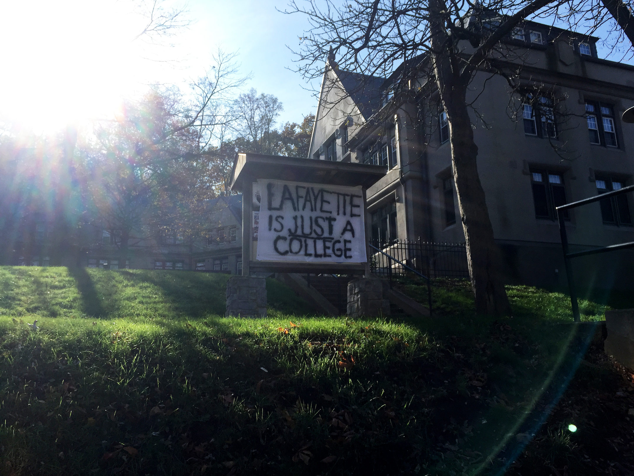"A sign reading ""Lafayette is just a college"" hangs in front of Taylor Dorm on Wednesday, Nov. 15, 2017. The sign is referencing Lehigh being a university. (Sarah Epstein/B&W Staff)"