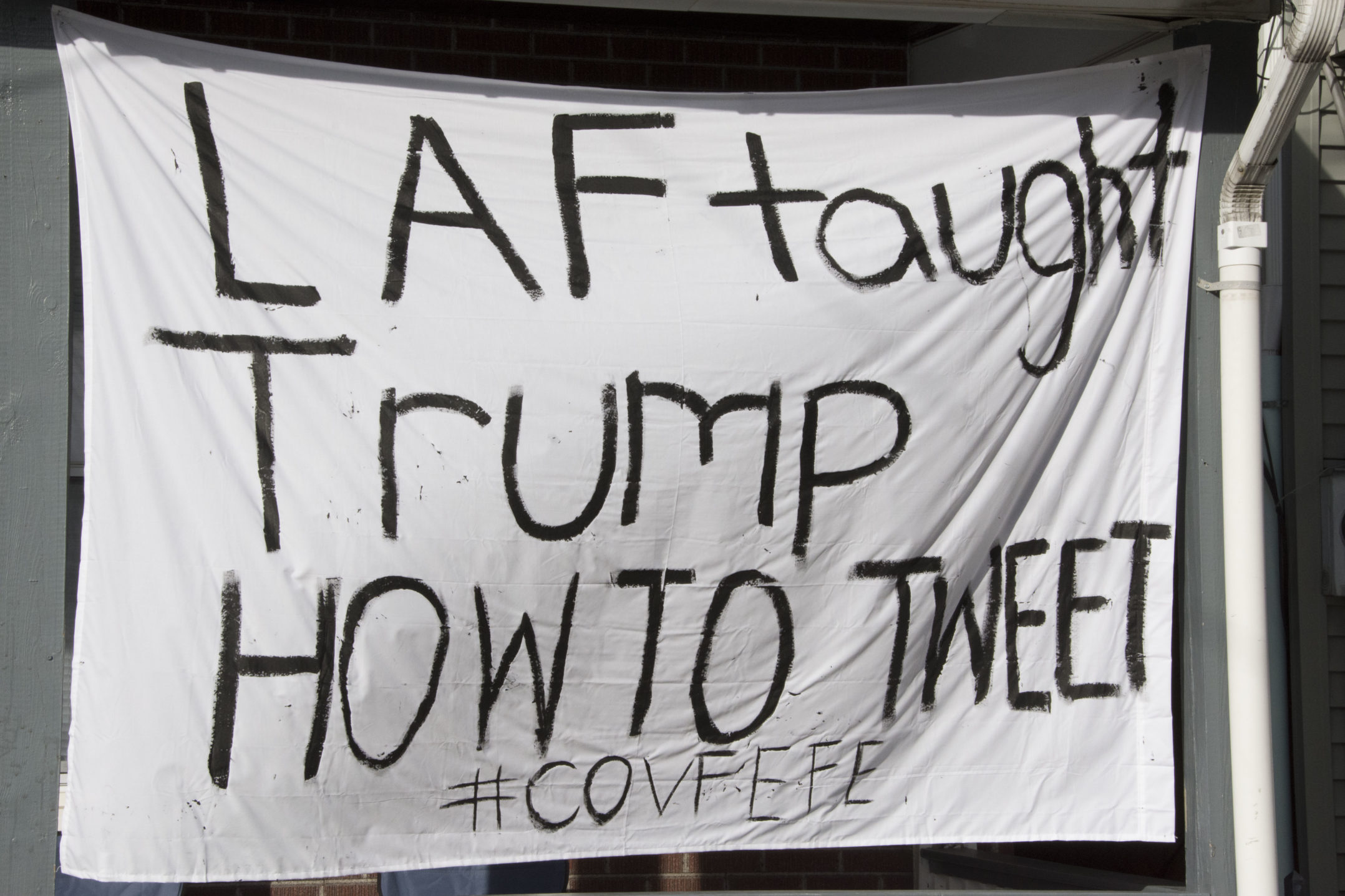 "A sign reading ""Laf taught Trump how to tweet #covfefe"" hangs from a house on E. Fifth Street on Wednesday, Nov. 15, 2017. The sign is referencing President Trump's tweet of the word ""covfefe"" earlier in 2017. (Annie Henry/B&W Staff)"