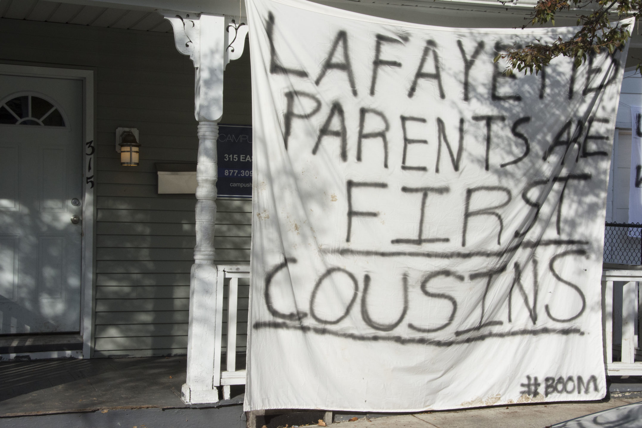 "A banner reading ""Lafayette's parents are first cousins"" hangs on a house on E. Fifth Street on Wednesday, Nov. 15, 2017. Many Lehigh students hang banners on their homes making fun of Lafayette in the spirit of Rivalry week. (Annie Henry/B&W Staff)"